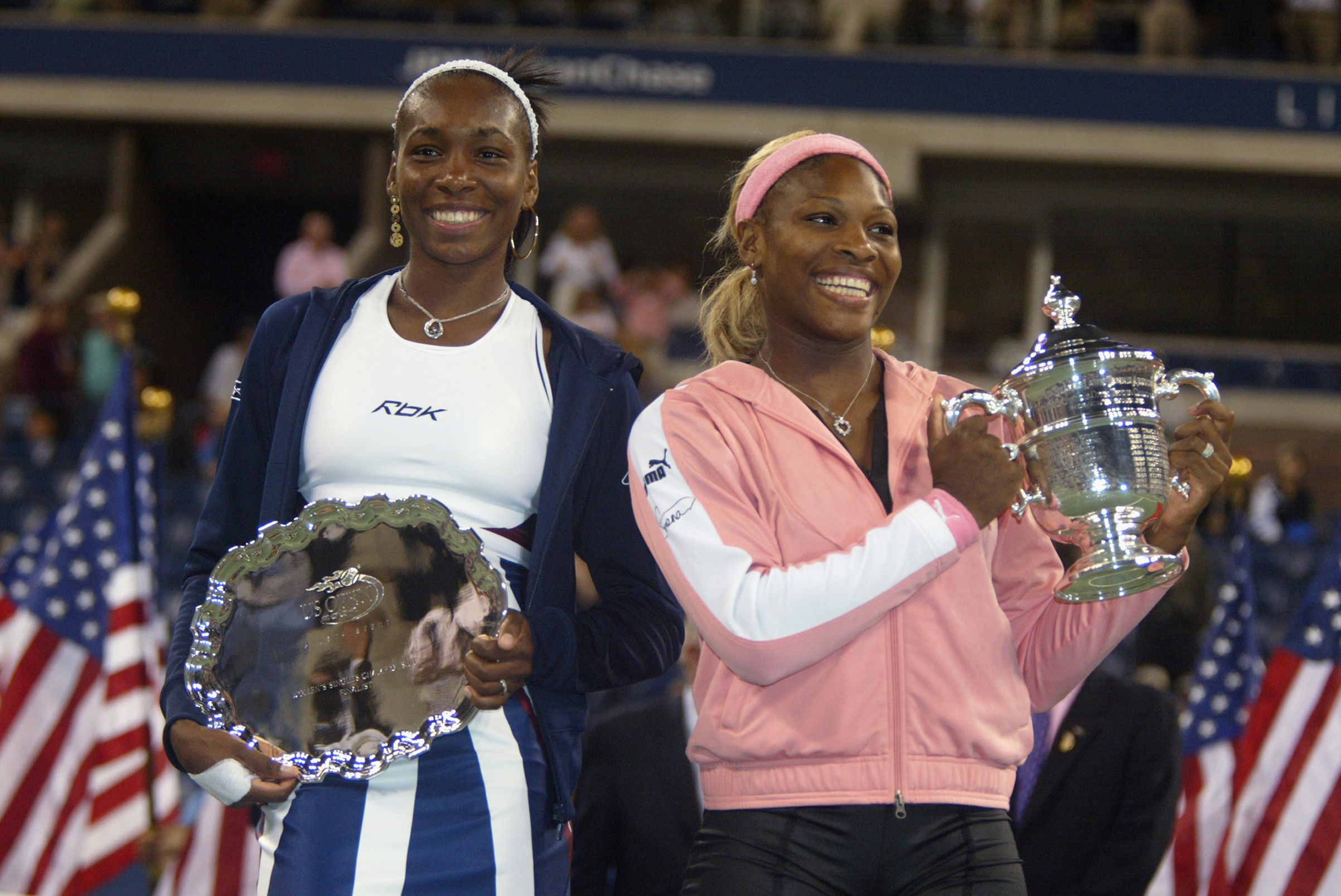 Venus Williams (L) of the USA and Serena Williams of the USA pose for photographers after the women's final of the US Open at the USTA National Tennis Center on September 7, 2002 in Flushing Meadows-Corona Park, New York. Serena Williams defeated her sister and won the US Open.