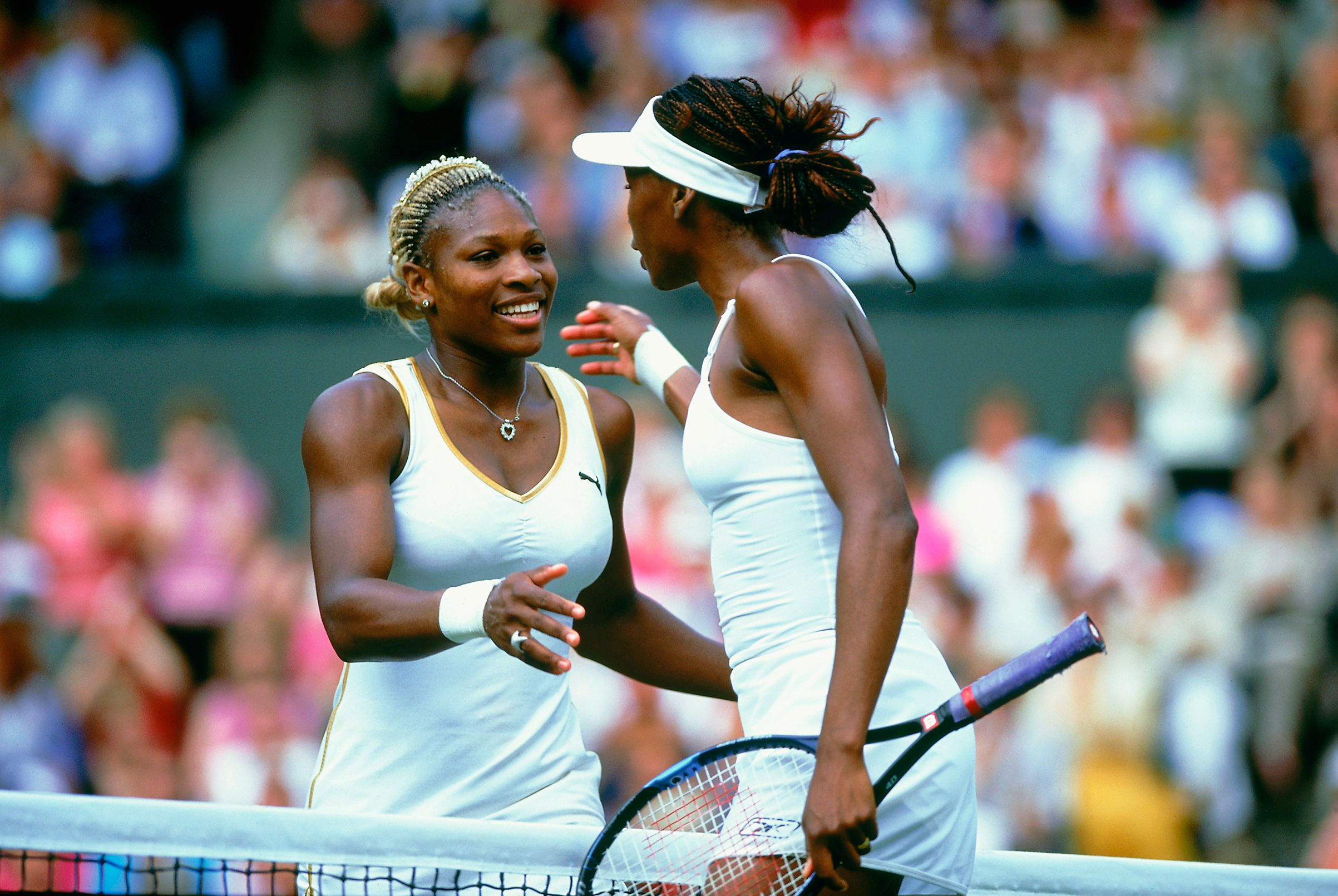 Serena Williams of the USA is congratulated by her sister Venus Williams after winning the Ladies Final at the Wimbledon Lawn Tennis Championship held at the All England Lawn Tennis and Croquet Club in Wimbledon, London on July 6, 2002.