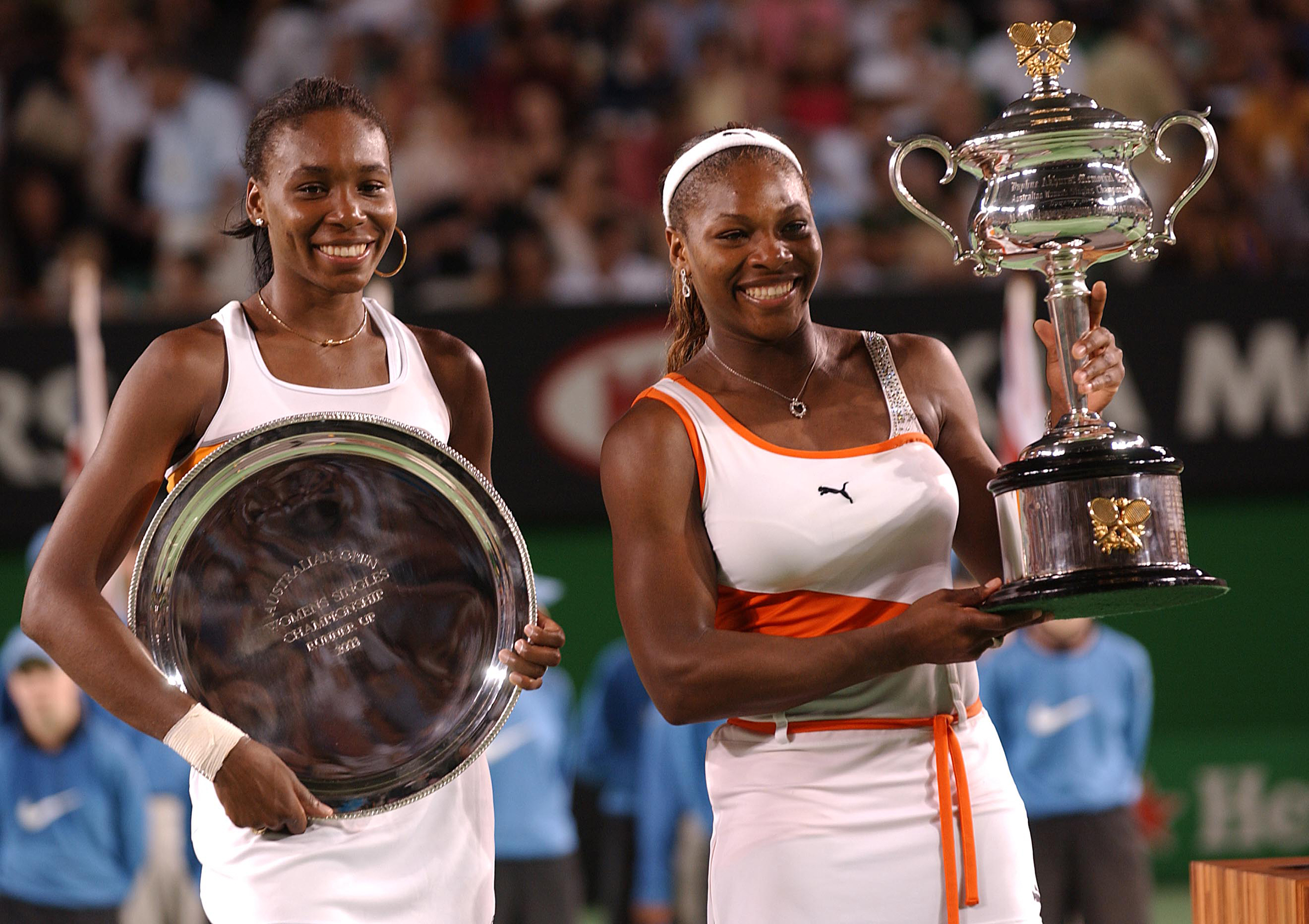 Serena and Venus Williams with their trophys after Serena beat her sister in the Womens Singles Final