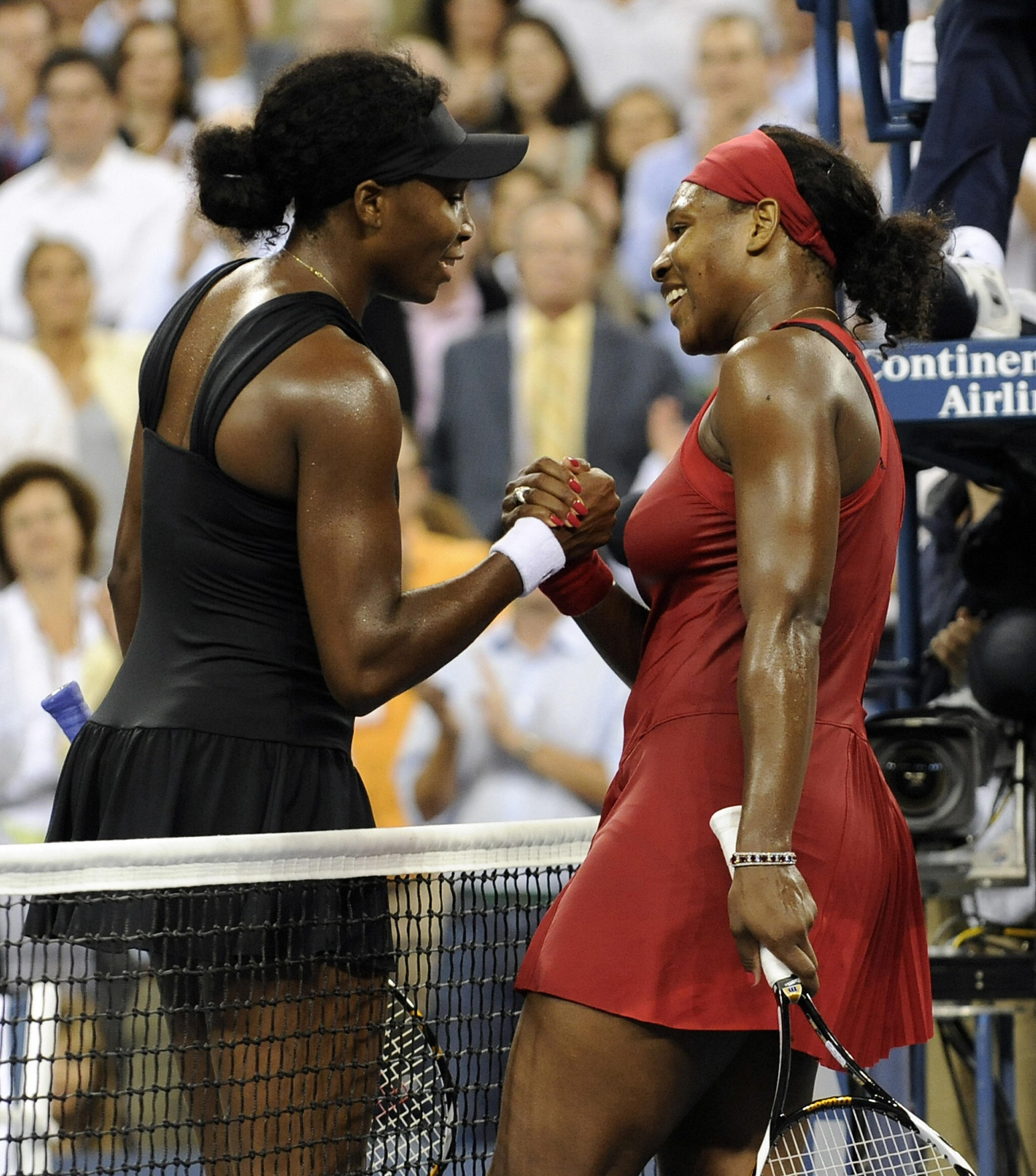 Serena Williams (R) of the United States (4) after winning during her quarterfinal match against Venus Williams of the United States (7) at the US Open tennis tournament on September 3, 2008 at the USTA National Tennis Center in New York City.