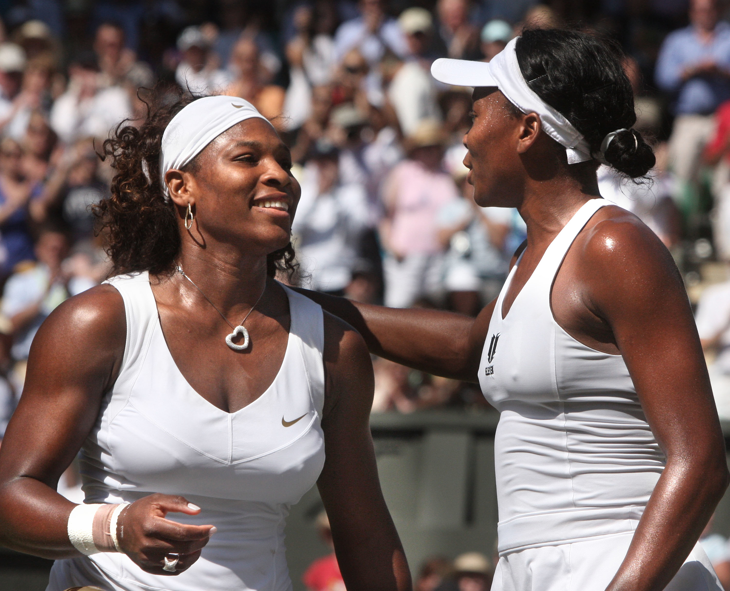 July 4, 2009 Serena Williams her sister Venus meet at the net after Serena defeated Venus 7-6, 6-2 in the final of the Wimbledon Championships at the All England Lawn Tennis Club, Wimbledon, England on Jul, 4 2009.
