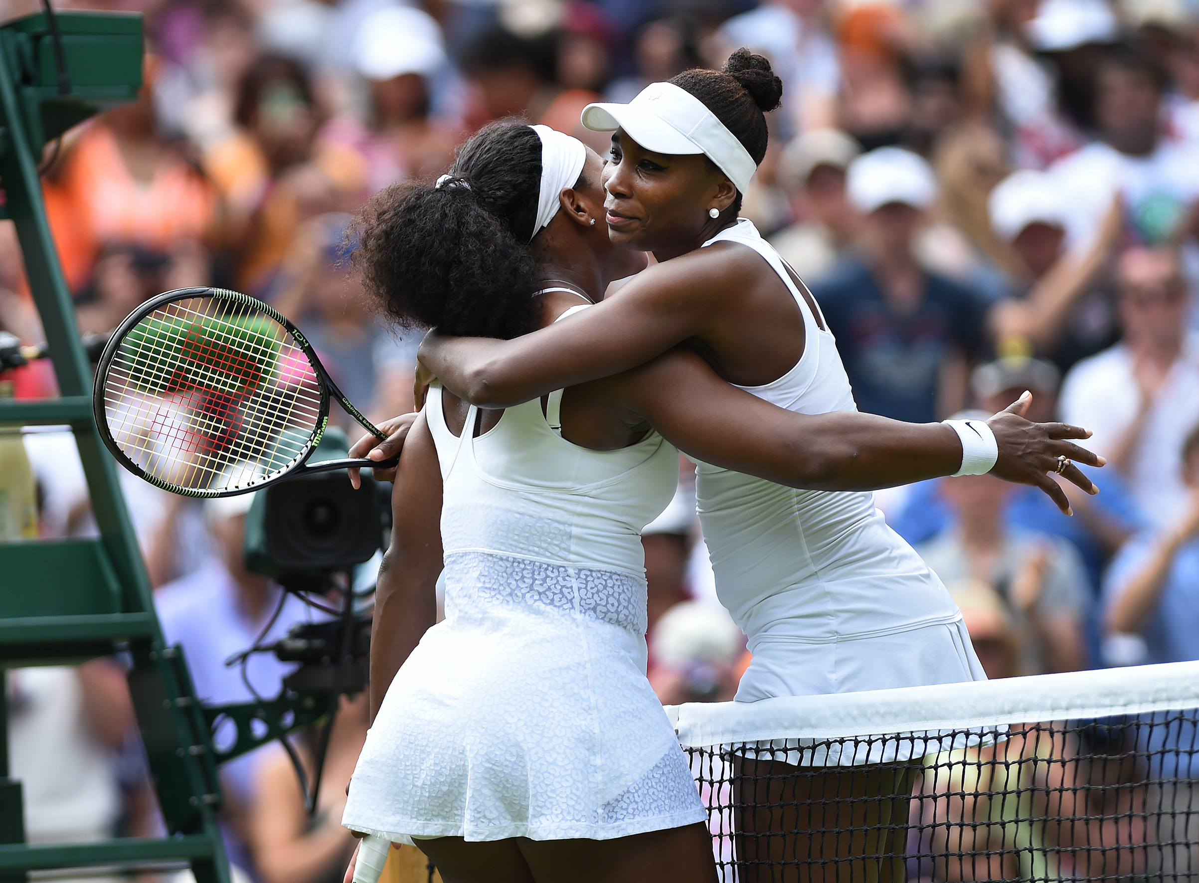 Venus Williams of USA embraces her sister after her fourth round match against Serena Williams of USA on Day Seven of the 2015 Wimbledon Lawn Tennis Championships at the All England Lawn Tennis and Croquet Club in London, UK.