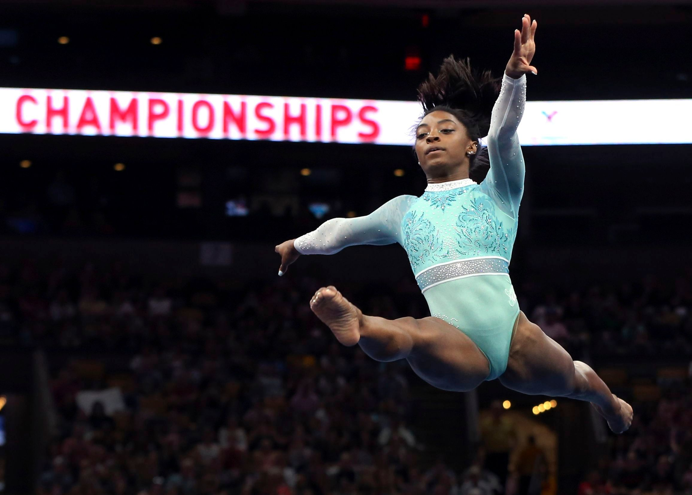 Mandatory Credit: Photo by Elise Amendola/AP/REX/Shutterstock (9794399g)                   Simone Biles competes on the floor exercise at the U.S. Gymnastics Championships, in Boston                   US Championships Gymnastics, Boston, USA - 19 Aug 2018