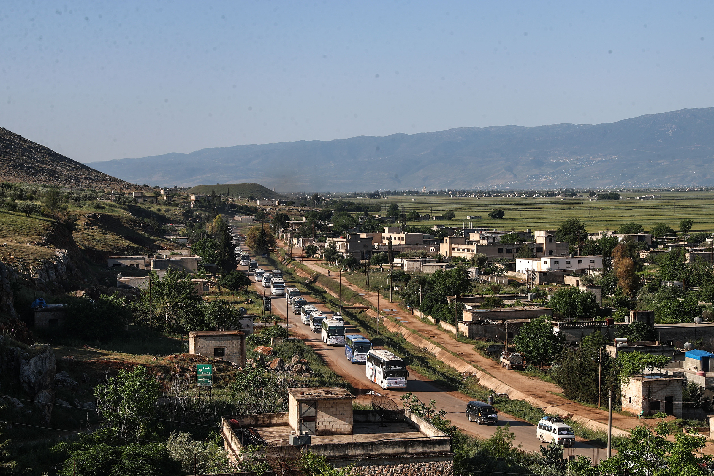 Defeated Syrian rebels fled to Idlib in April in a convoy of buses; the province is now under threat