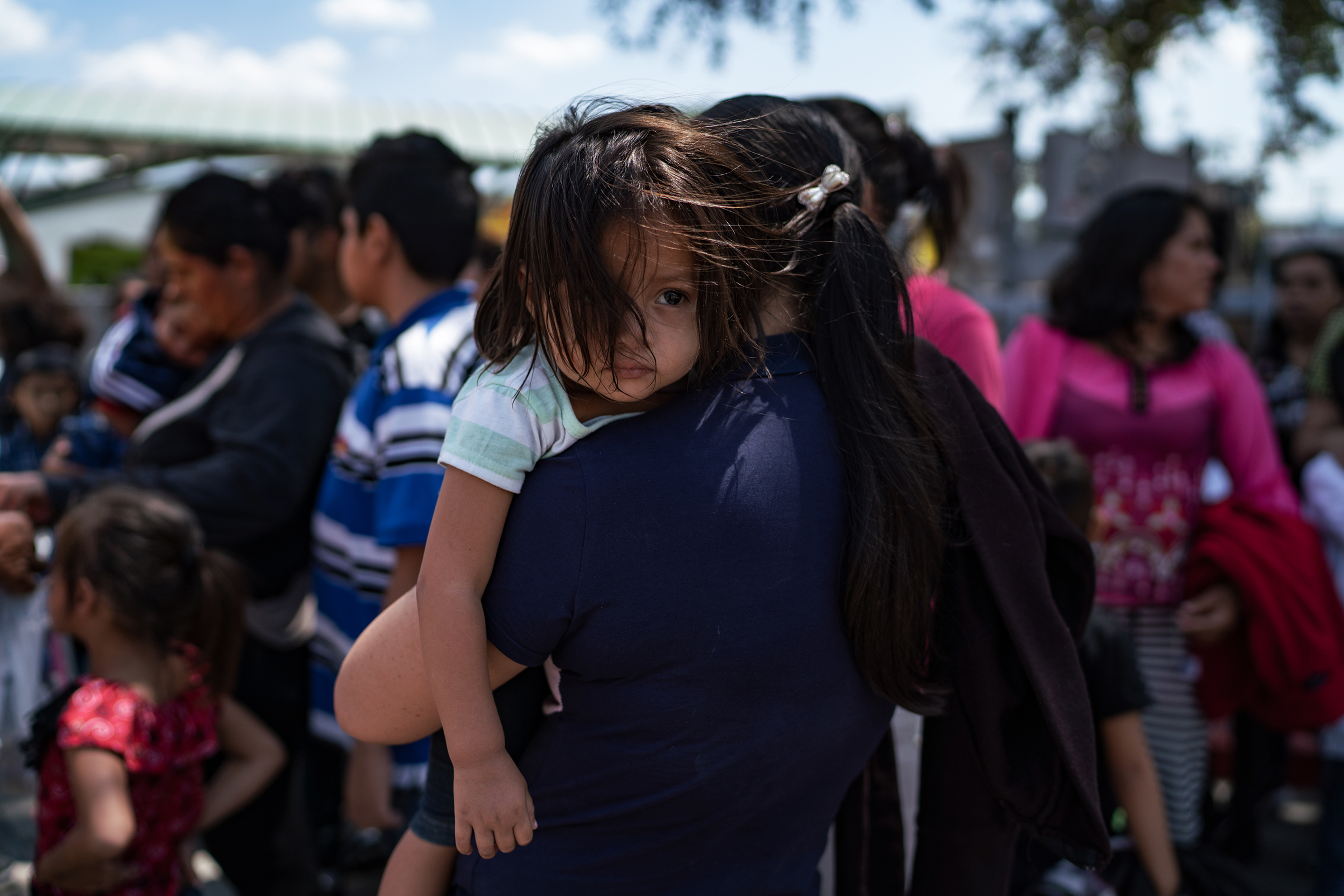 Central American asylum seekers wait at the bus station in McAllen, Texas, to be taken to the Catholic Charities Humanitarian Respite Center on Aug. 2, 2018.