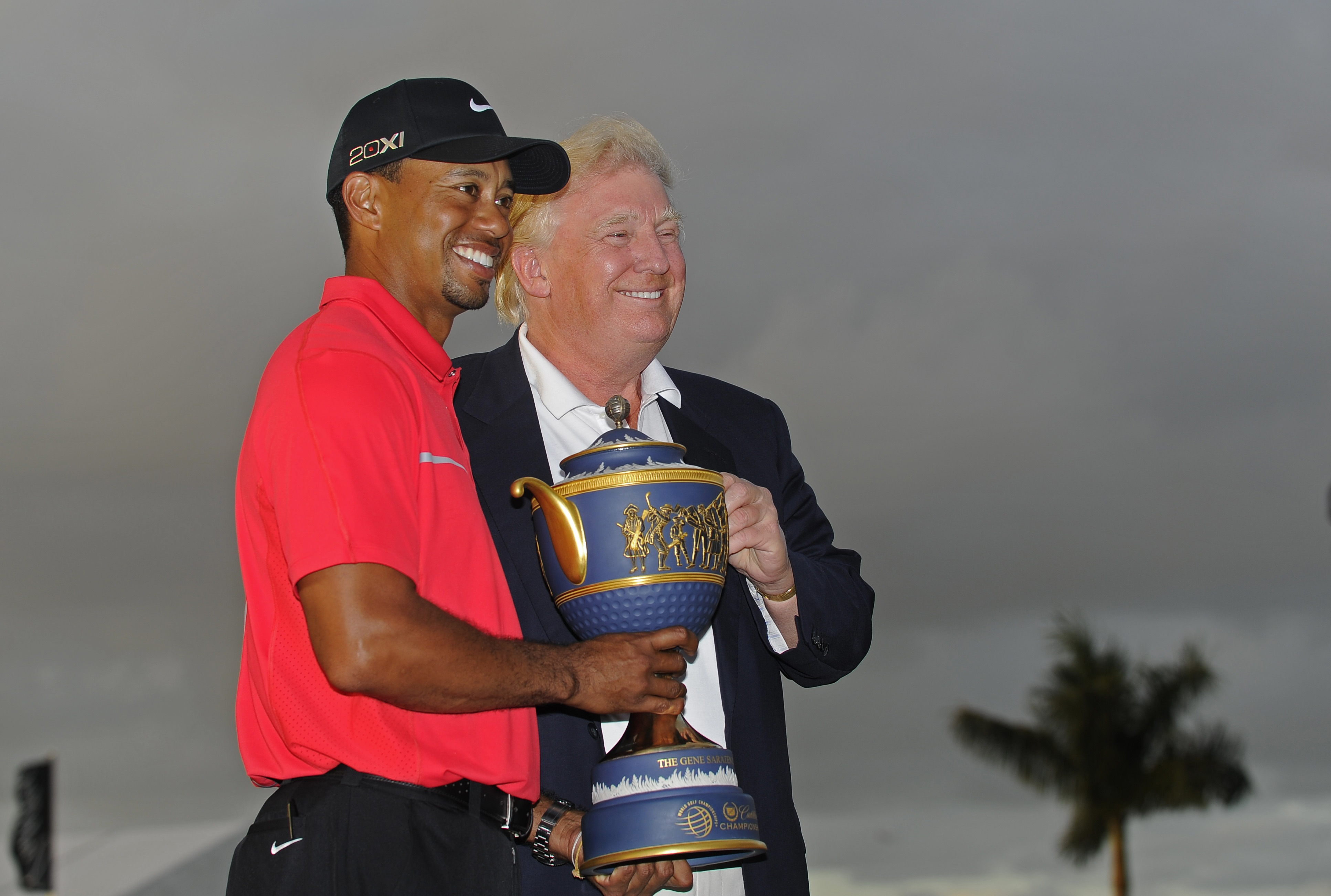 Tiger Woods poses with the Gene Sarazen Cup and Donald Trump after winning the World Golf Championships-Cadillac Championship at TPC Blue Monster at Doral on March 10, 2013 in Doral, Florida.