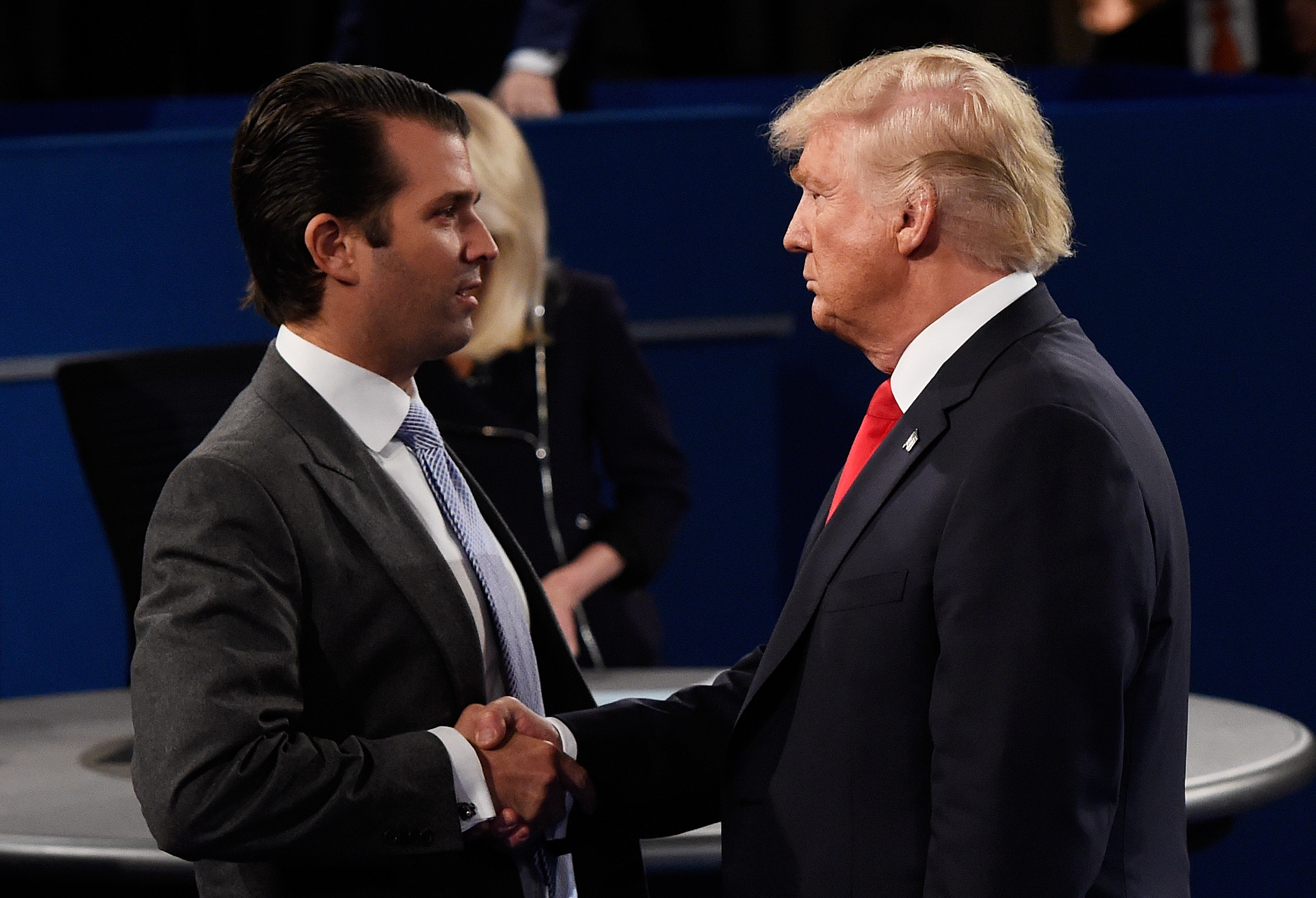 In this file photo, Donald Trump, Jr. (L) greets his father Donald Trump during the town hall debate at Washington University on October 9, 2016 in St Louis, Missouri.