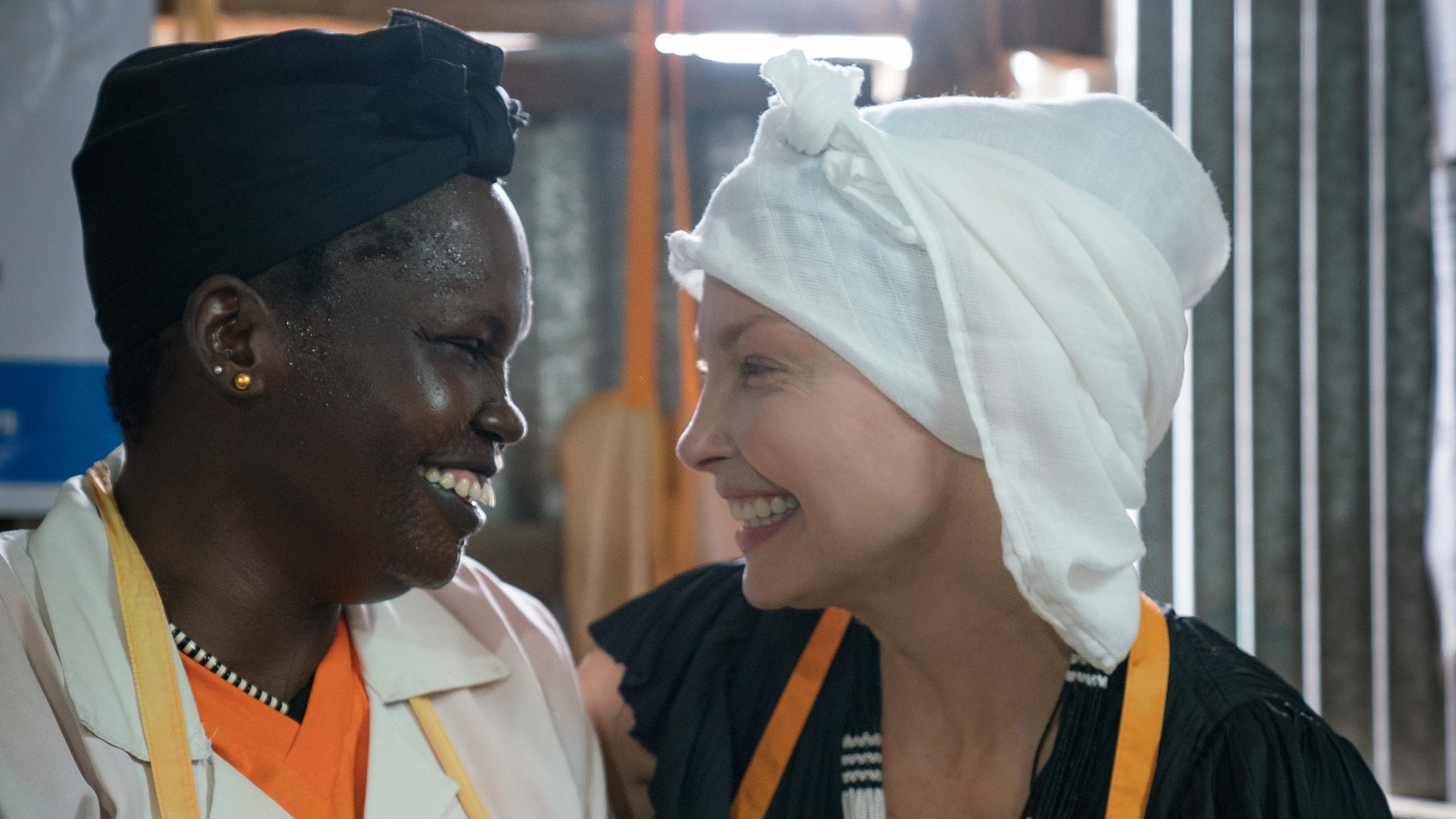 Ashley Judd and Theresa (lead midwife) smile after the safe delivery of baby named Ashley to her mother, Nyakal. Taken at International Rescue Committee clinic supported by UNFPA, Bentiu Protection Of Civilians Site, South Sudan.