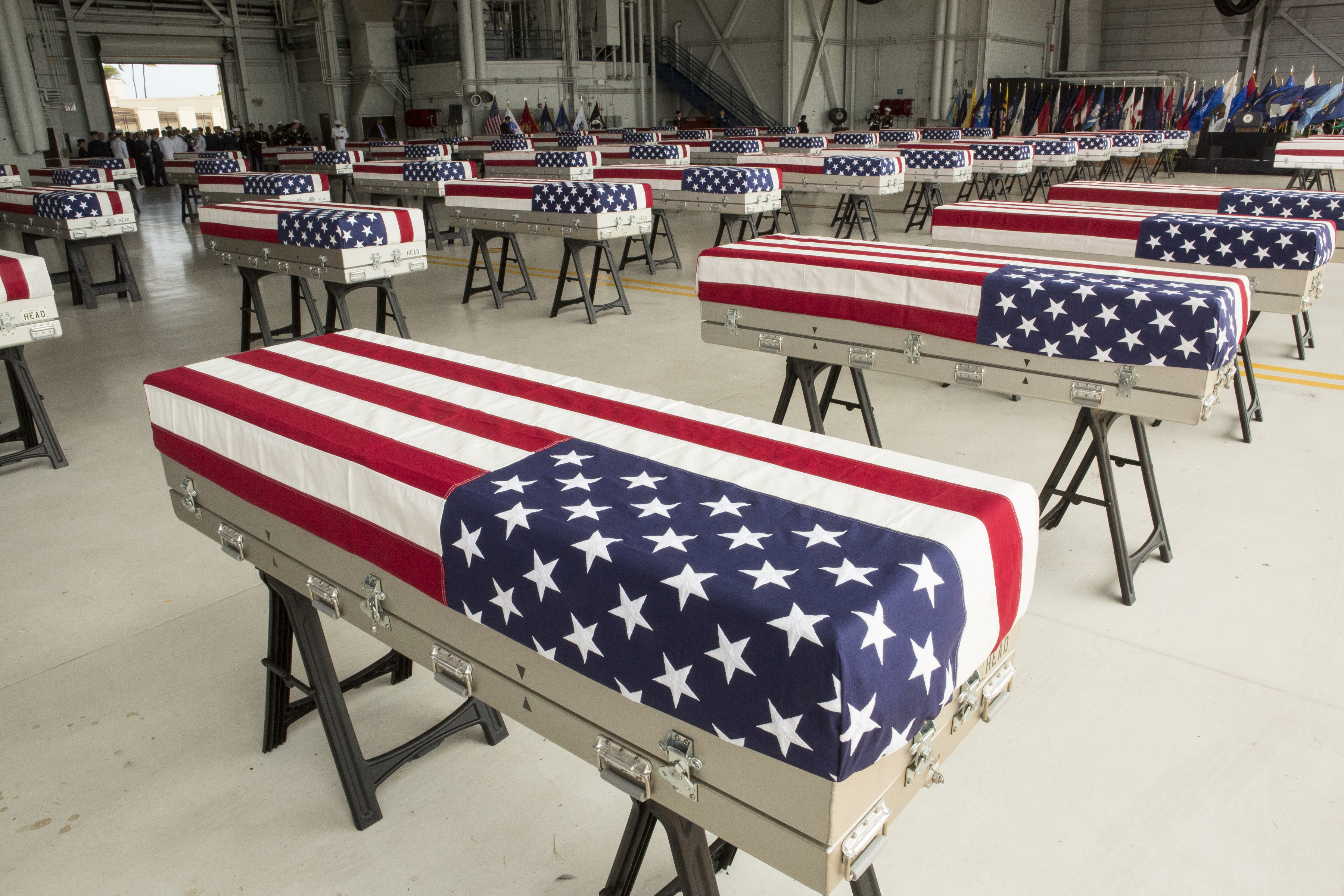 Military personnel bring in the presumed remains of US soldiers in 55 caskets draped with American flags into Hanger 19 Joint base Pearl Harbor Hickam on August 1, 2018 in Honolulu, Hawaii. (Kat Wade—Getty Images)