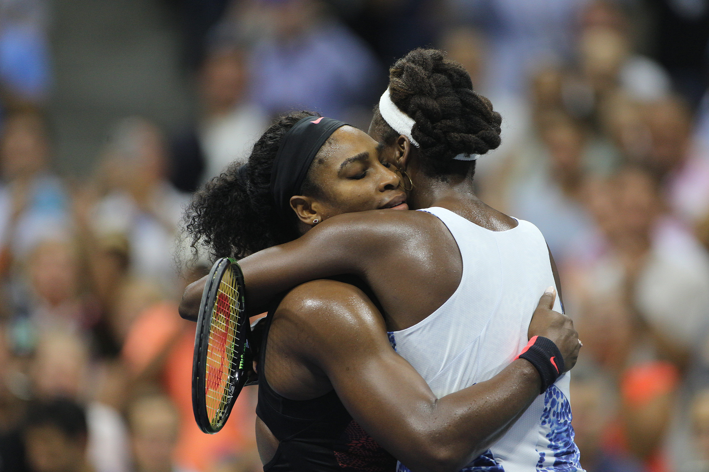 Serena Williams, USA and sister Venus Williams, USA, embrace after in their Women's Singles Quarterfinals match won by Serena during the US Open Tennis Tournament, Flushing, New York, USA on Sept 8, 2015.