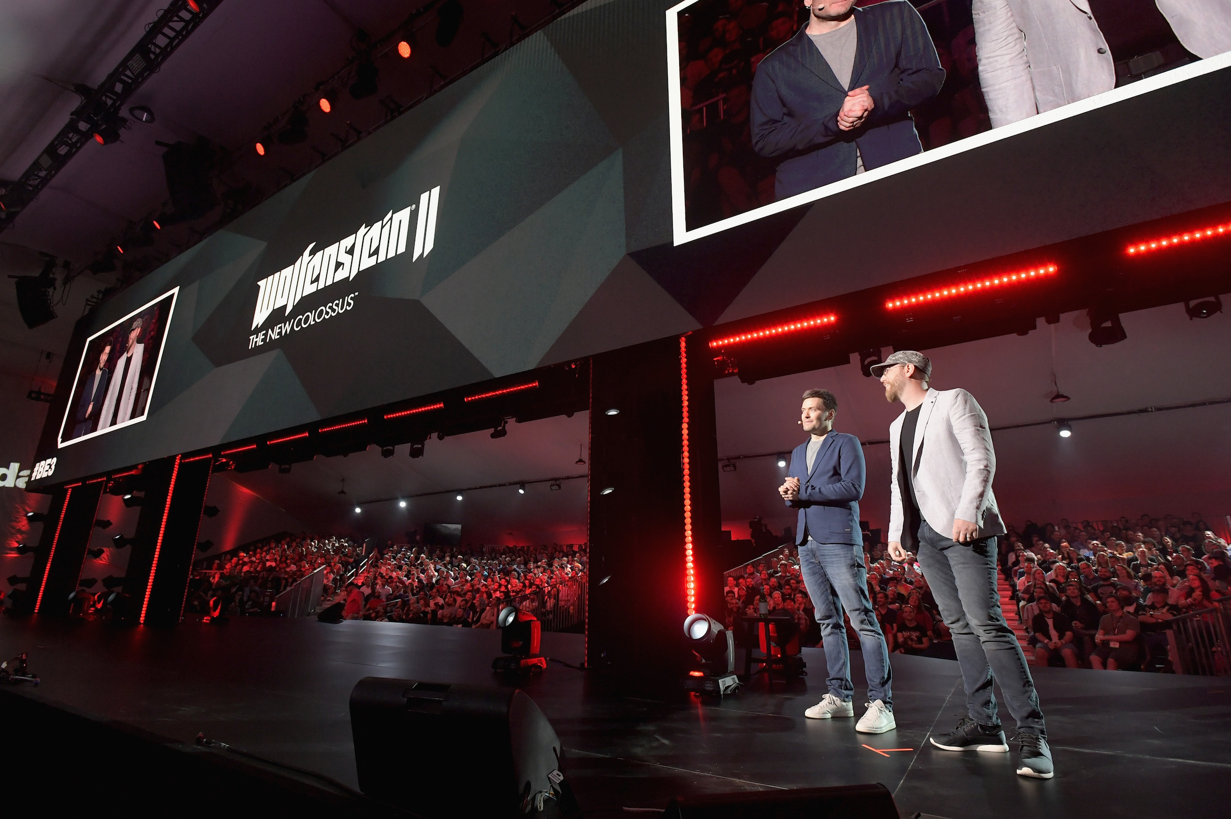 Jerk Gustafsson (L) and Jens Matthies of MachineGames present 'Wolfenstein II' onstage as Bethesda Softworks shows off new video game experiences at its E3 Showcase and at The Event Deck at LA LIVE on June 10, 2018, ahead of the Electronic Entertainment Expo (E3)  in Los Angeles.