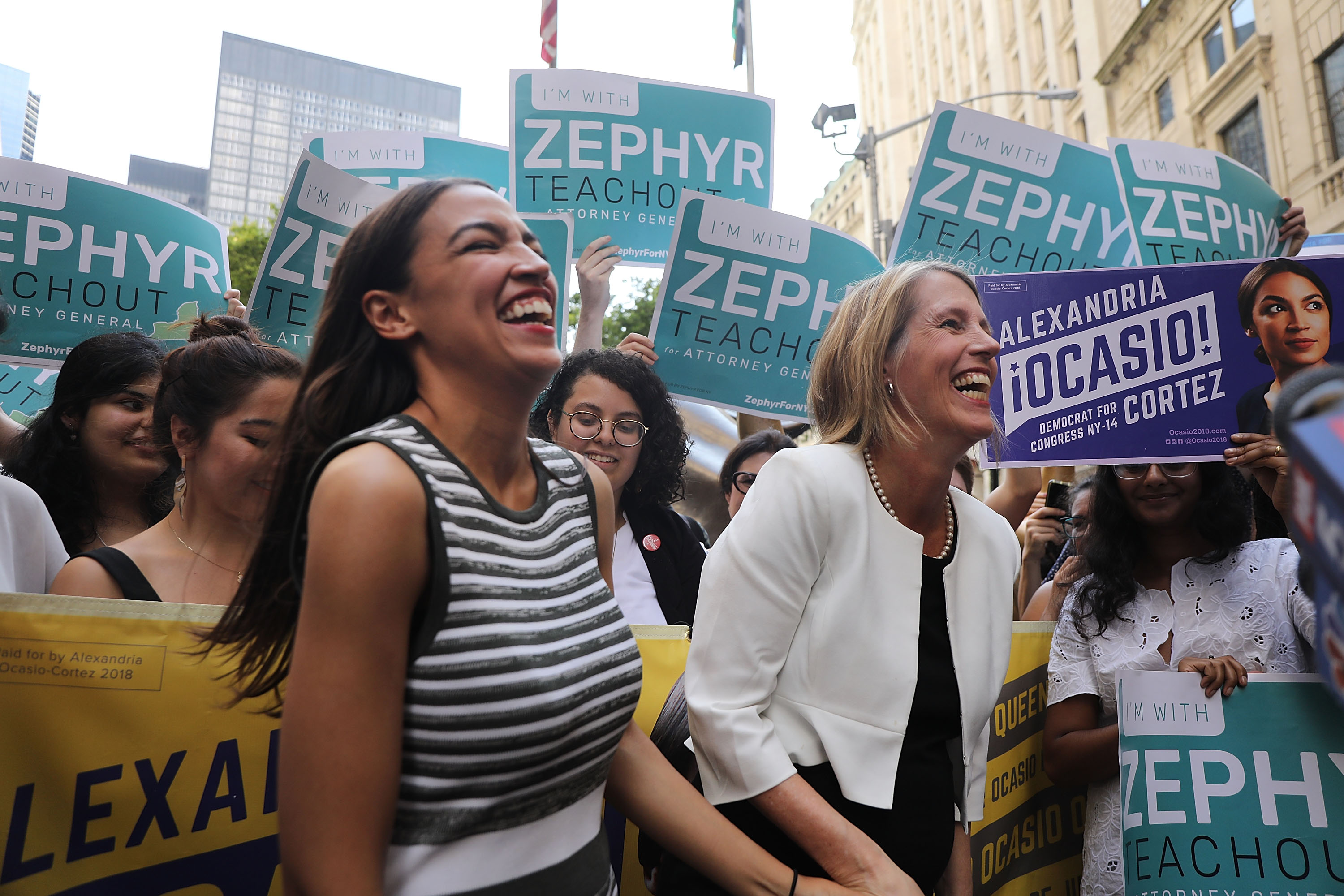 Congressional nominee Alexandria Ocasio-Cortez (L) stands with Zephyr Teachout.