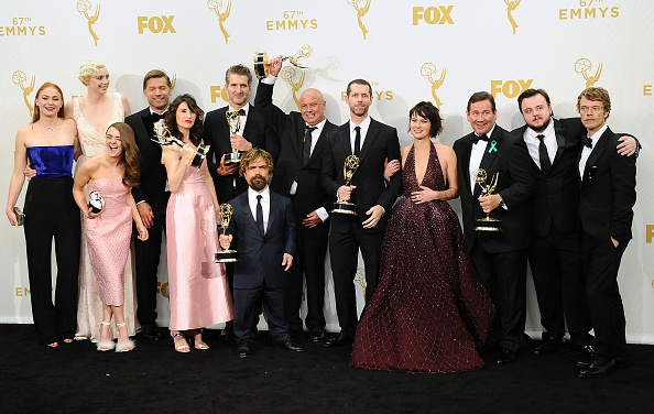 The cast and writers of Game of Thrones pose in the press room at the 2015 Emmy Awards