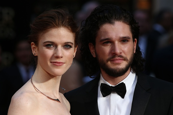 Rose Leslie and Kit Harington pose on the red carpet upon arrival to attend the 2016 Laurence Olivier Awards in London on April 3, 2016.