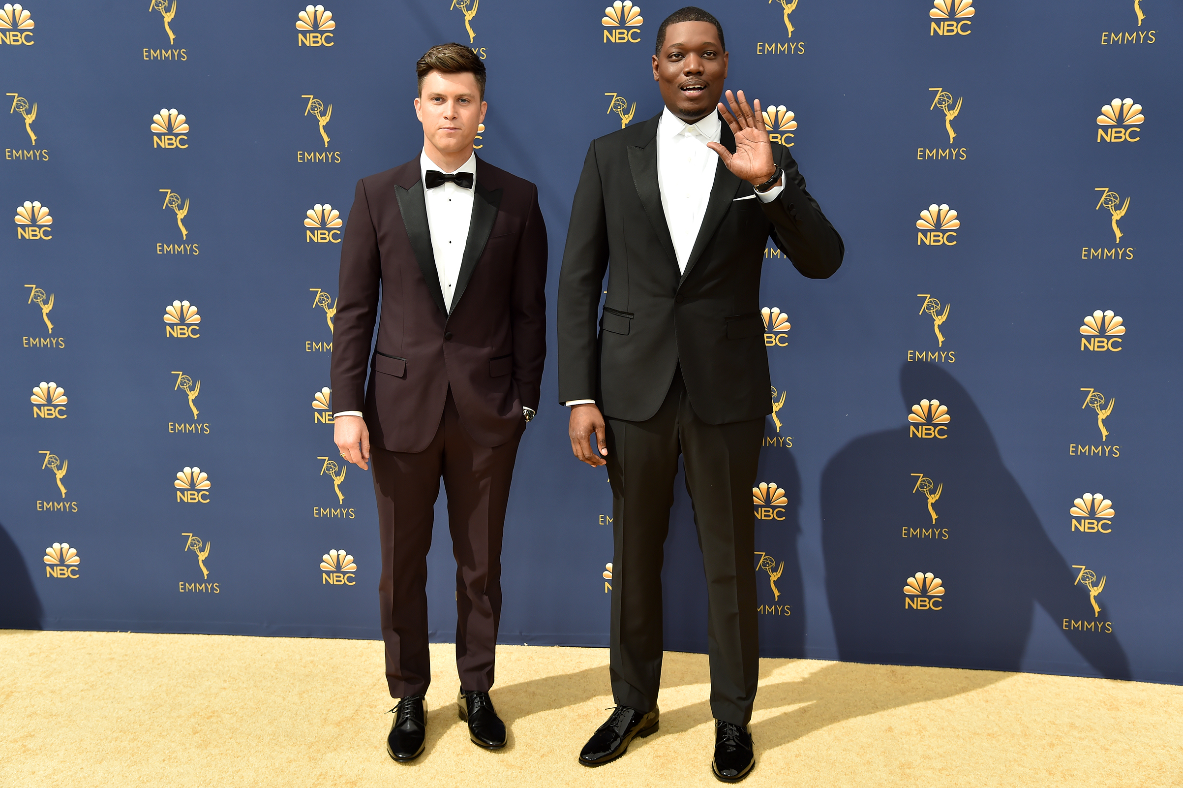 Hosts Colin Jost and Michael Che arrive at the 70th Emmy Awards on Sept. 17.