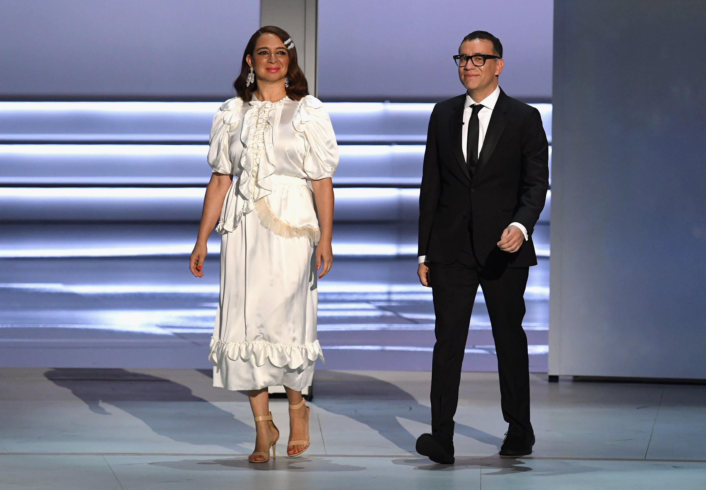 Maya Rudolph and Fred Armisen walk onstage during the 70th Emmy Awards at Microsoft Theater on Sept. 17, 2018 in Los Angeles.