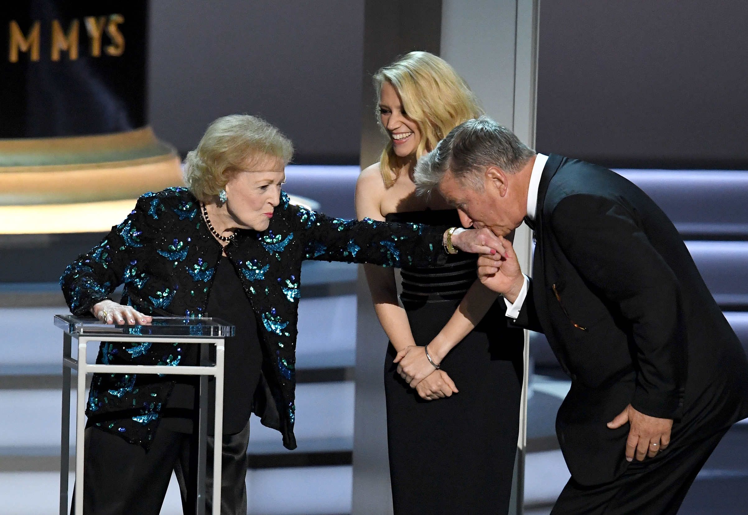 Betty White, Kate McKinnon, and Alec Baldwin speak onstage during the 70th Emmy Awards at Microsoft Theater on Sept. 17, 2018 in Los Angeles.