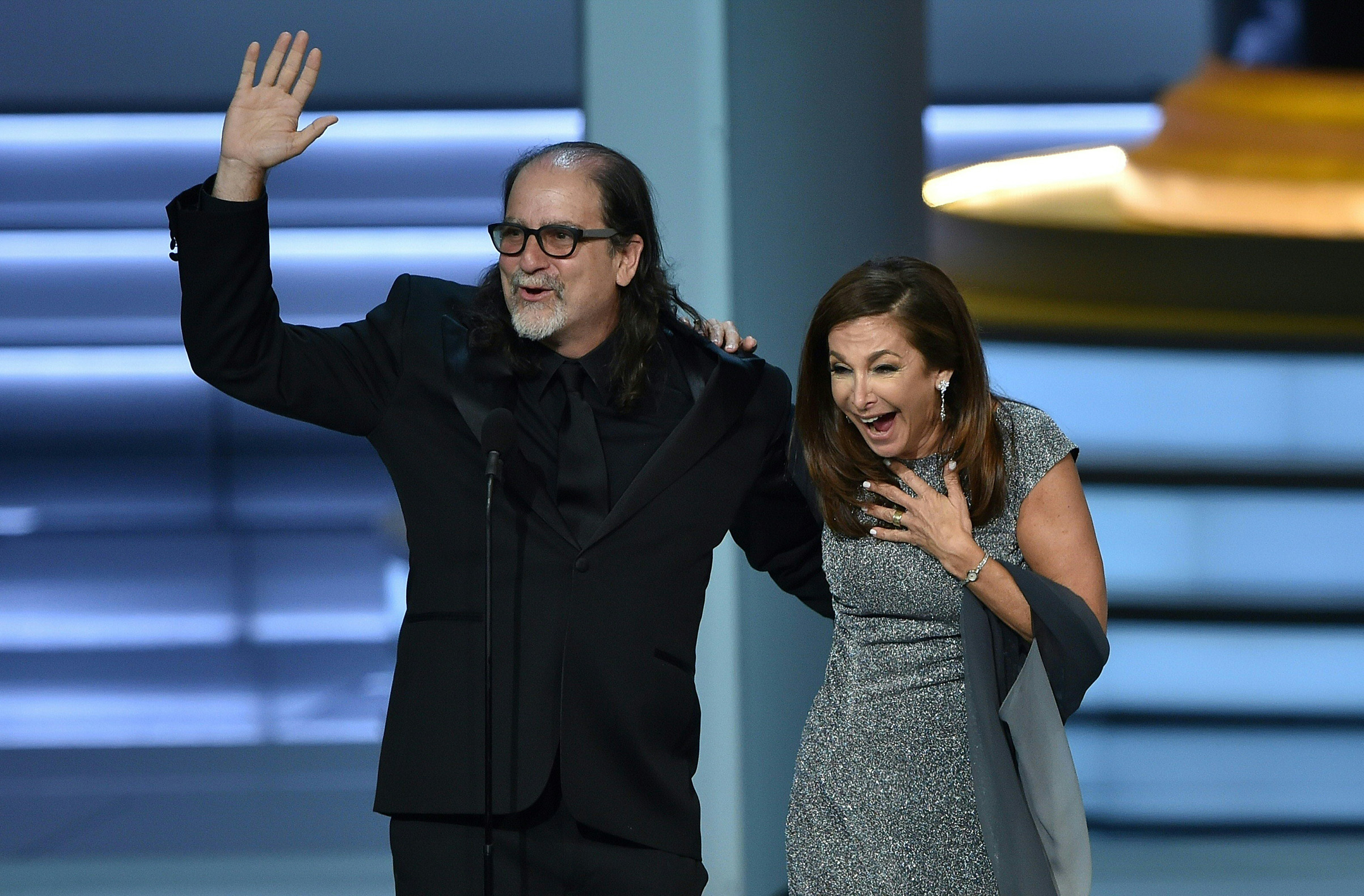 Glenn Weiss, winner of the Outstanding Directing for a Variety Special award for 'The Oscars,' waves to the audience after proposing to Jan Svendsen onstage during the 70th Emmy Awards at the Microsoft Theatre in Los Angeles on Sept. 17, 2018.