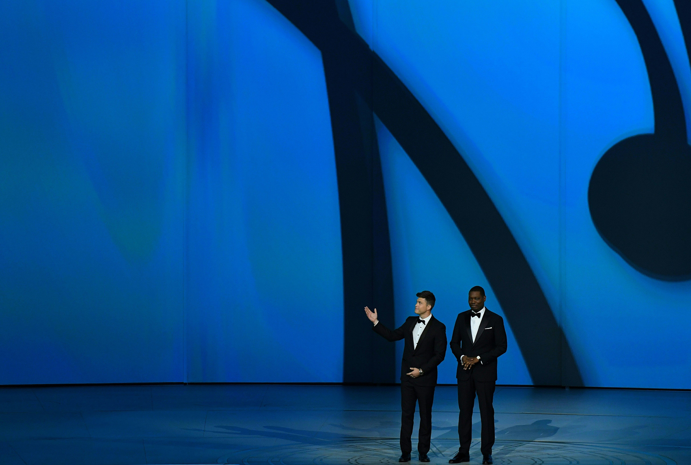 Hosts Colin Jost and Michael Che speak onstage during the 70th Emmy Awards at the Microsoft Theatre in Los Angeles on Sept. 17, 2018.