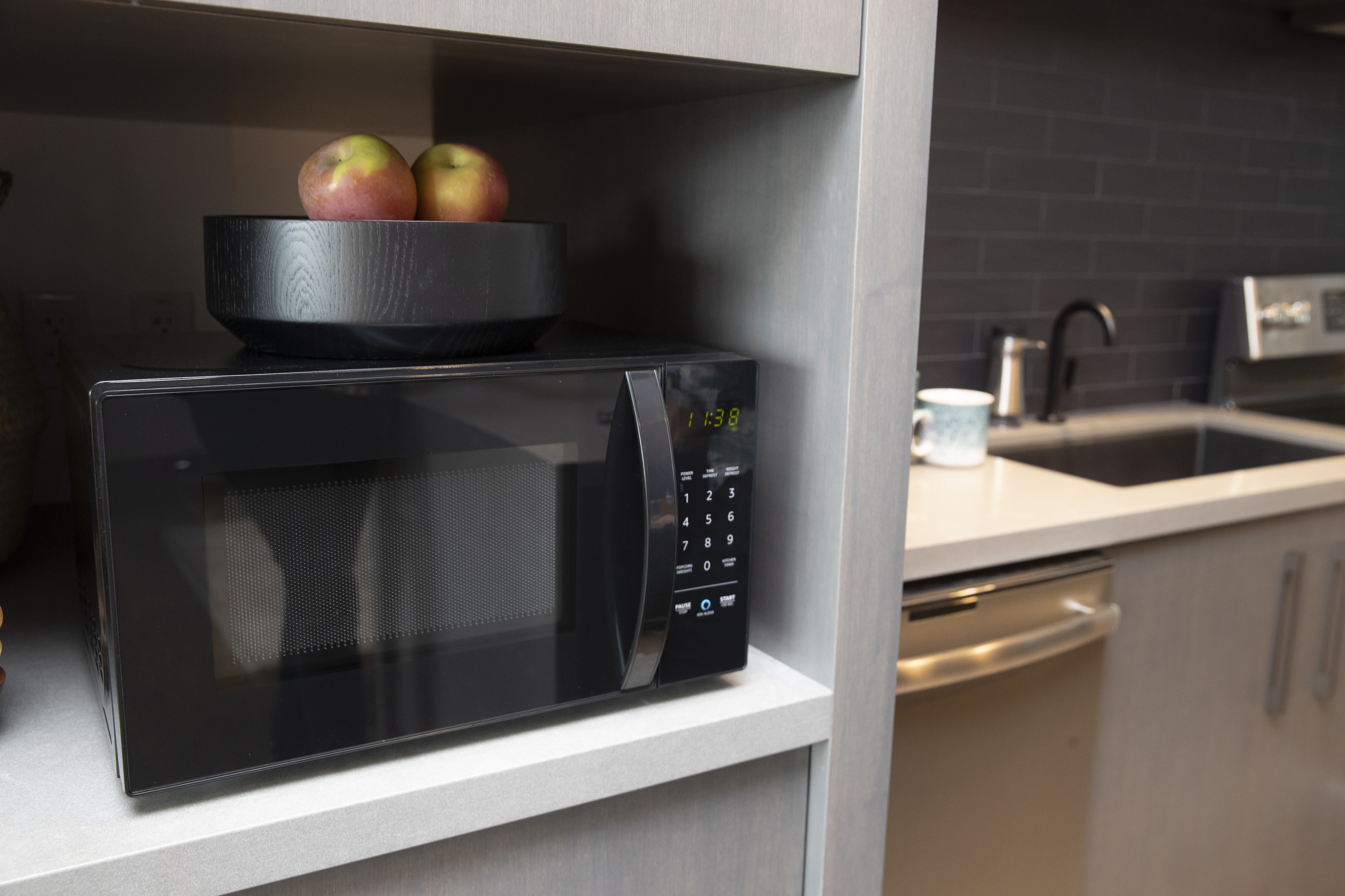 An  Amazonbasics Microwave,  which can be controlled by Alexa, is pictured at  Amazon Headquarters shortly after being launched, on September 20, 2018 in Seattle Washington.