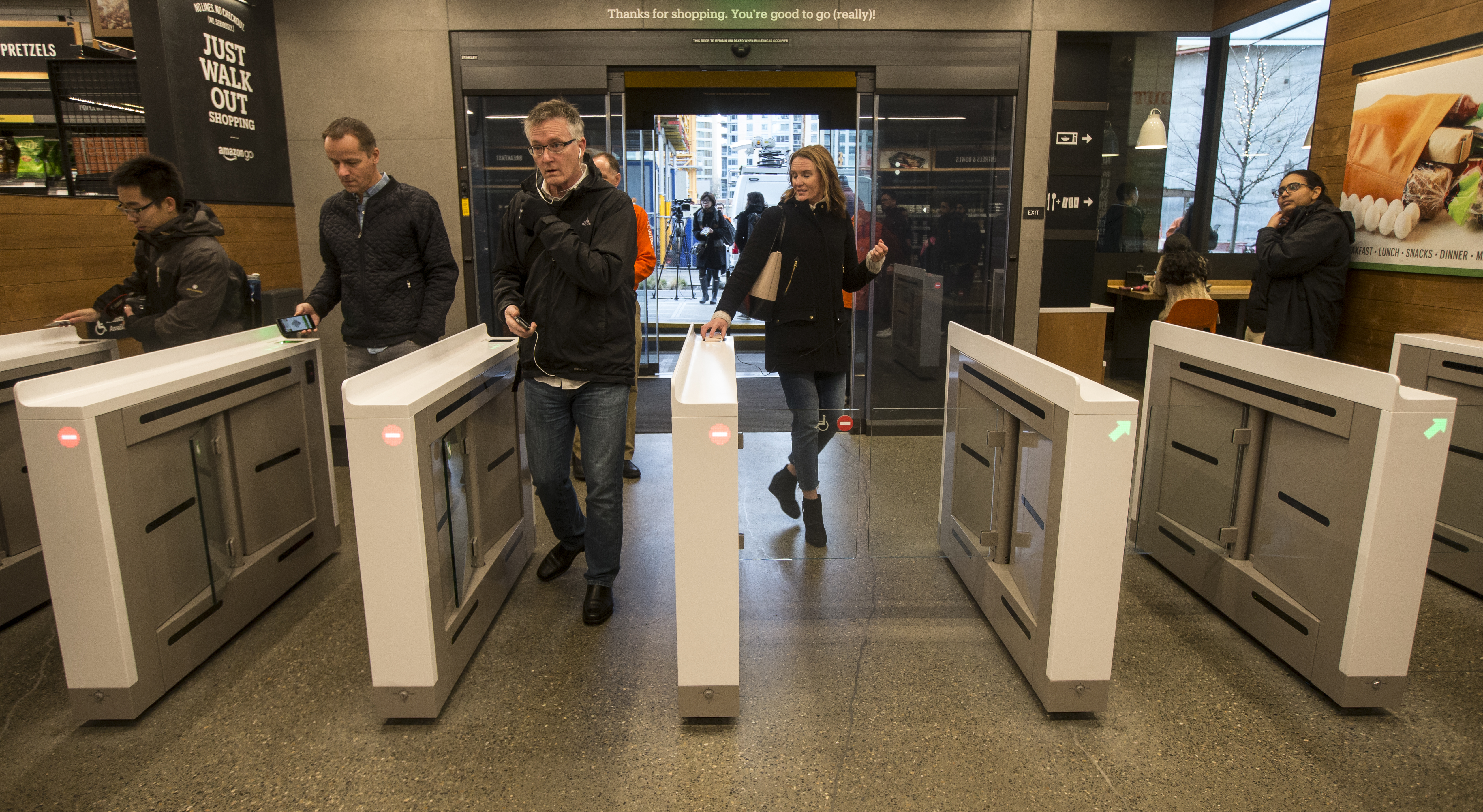 Shoppers scan the Amazon Go app on the mobile devices as the enter the Amazon Go store, on January 22, 2018 in Seattle, Washington.