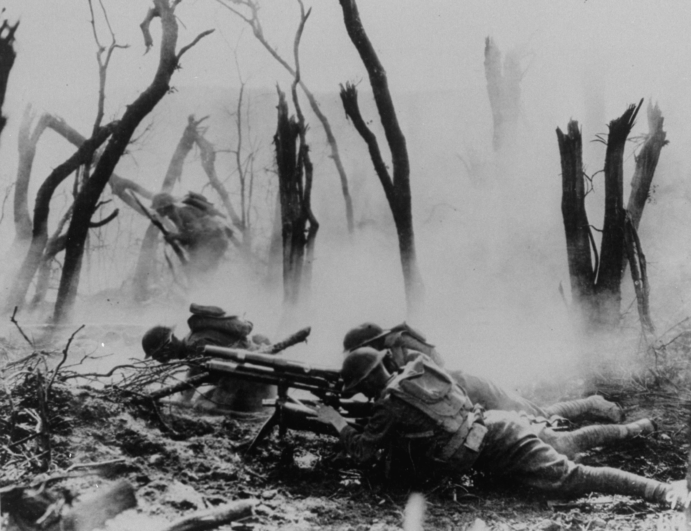 U.S. soldiers of the 23rd Infantry, 2nd Division, firing a 37mm machine gun at a German position in the Argonne Forest, during the Meuse-Argonne offensive in 1918.