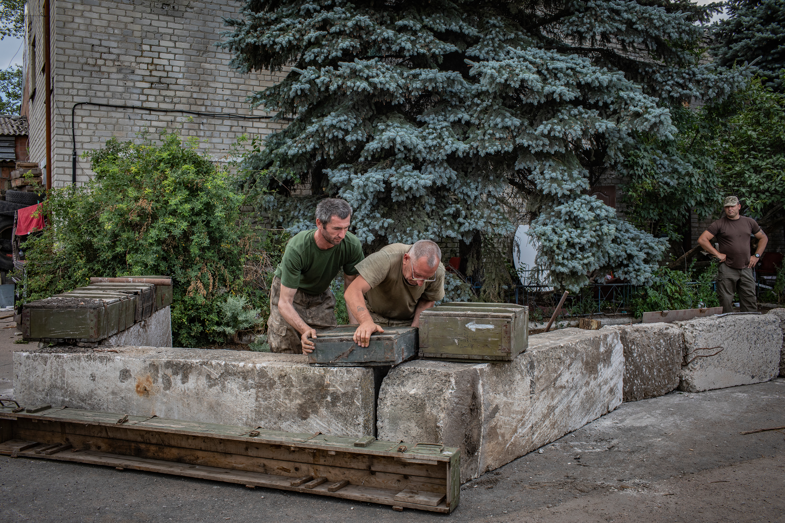 Members of the Ukrainian army build fortifications at a base near Peski. Soldiers spend most of their time watching the enemy's positions and sustaining their own living. Activities like digging trenches and building fortifications, cutting wood, cooking and doing laundry take up much more time than actual fighting.
