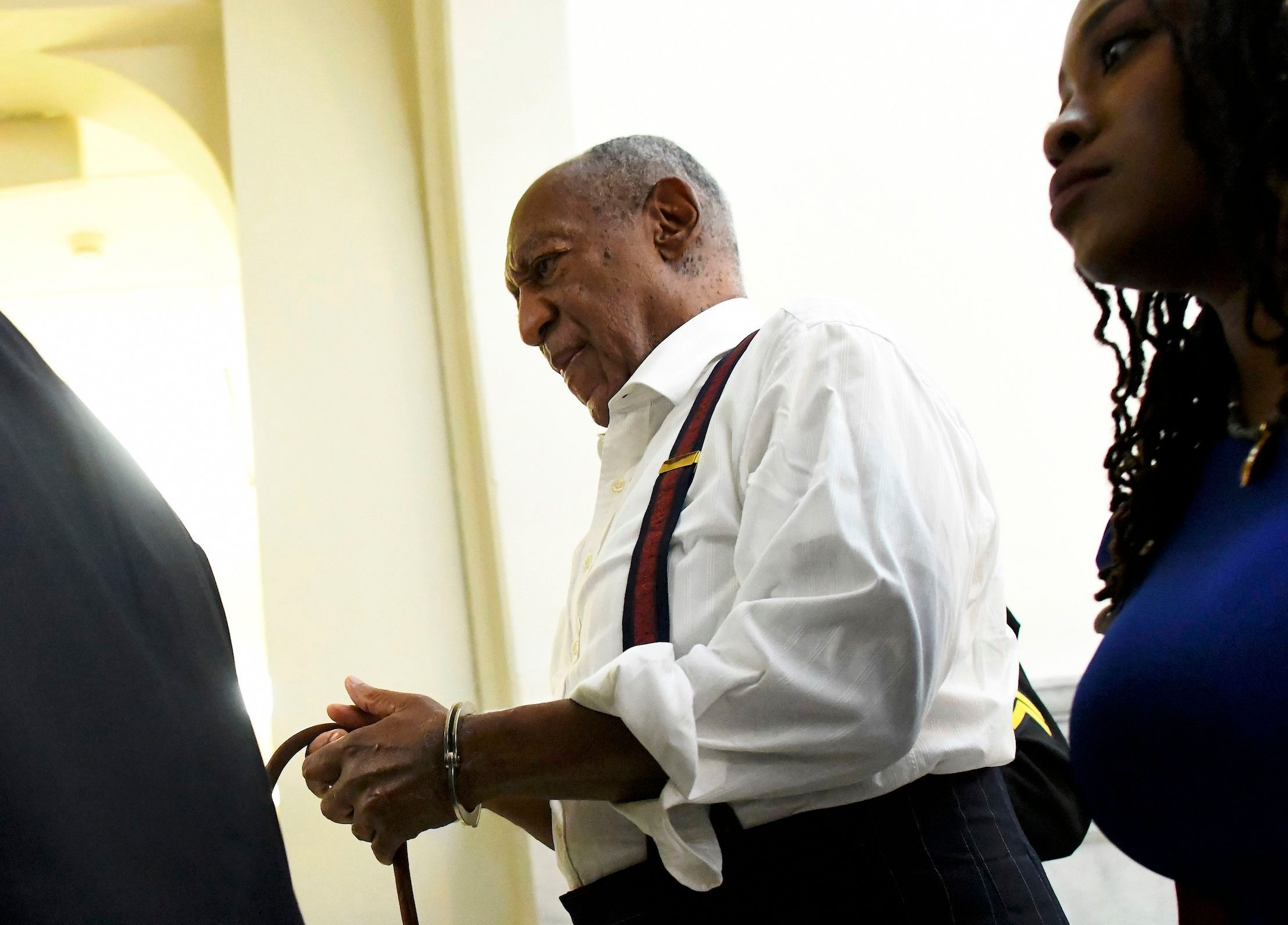 Mandatory Credit: Photo by Mark Makela/AP/REX/Shutterstock (9894720a)                       Bill Cosby is taken away in handcuffs after he was sentenced to three-to 10-years for felony sexual assault, in Norristown, Pa                       Bill Cosby, Norristown, USA - 25 Sep 2018