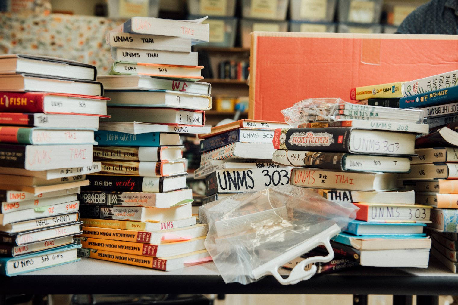 Stacks of books are organized in Binh Thai's classroom at the University Neighborhood Middle School in New York City.