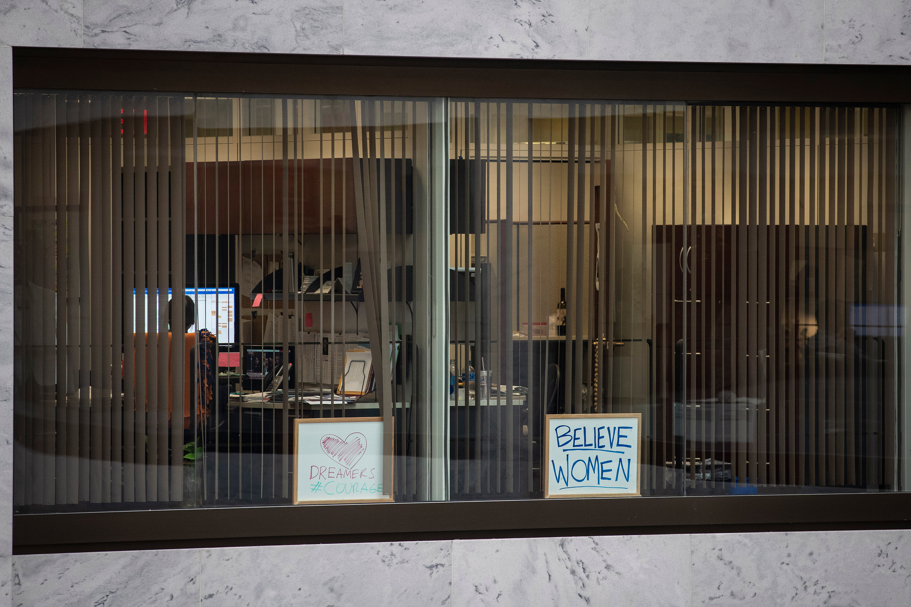 A sign reading 'Believe Women' sits in the window of an office in the Hart Senate Office Building on Capitol Hill on Sept. 27.