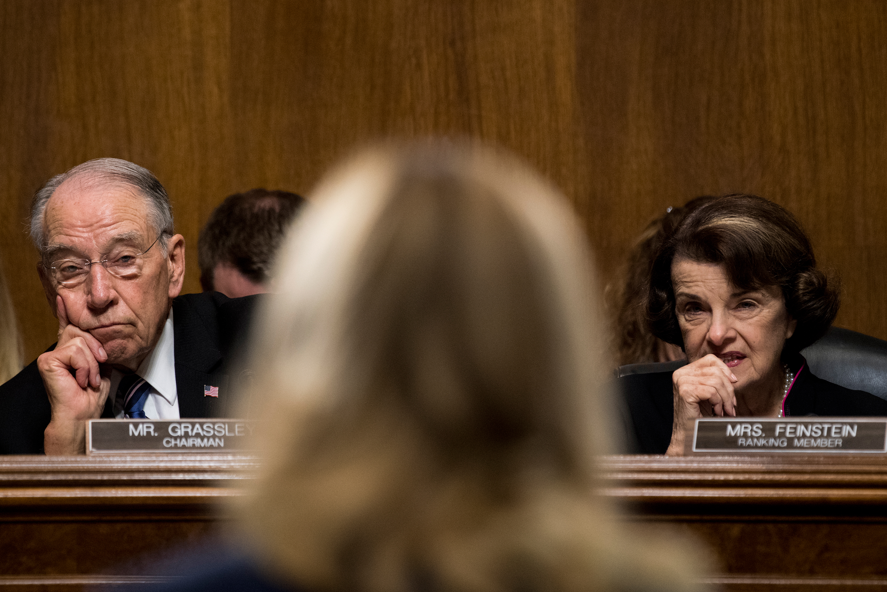 Sen. Chuck Grassley, R-Iowa, and Sen. Dianne Feinstein, D-Calif., listen as Dr. Christine Blasey Ford testifies on Sept. 27.