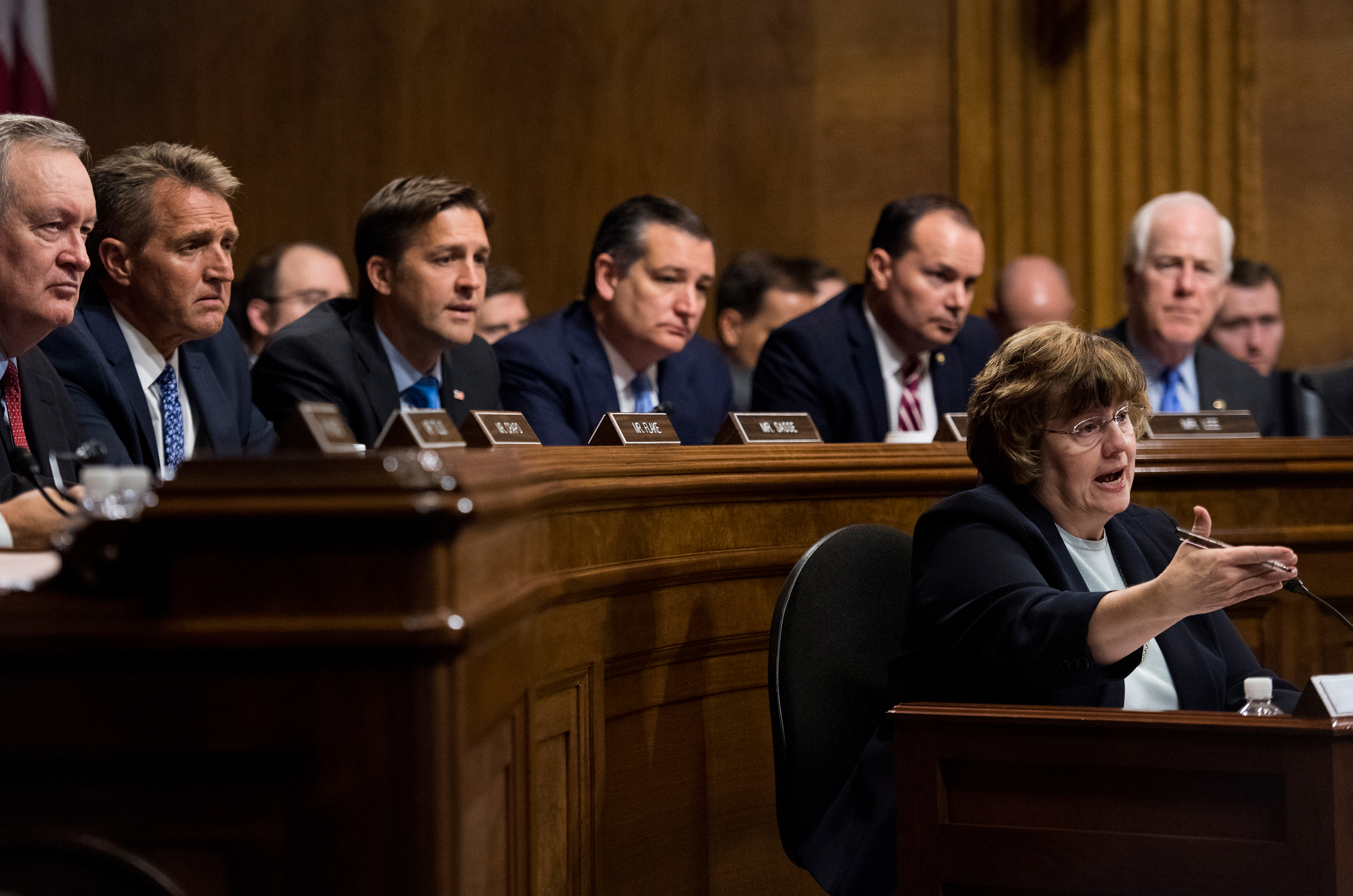 Rachel Mitchell, counsel for Senate Judiciary Committee Republicans, questions Dr. Christine Blasey Ford as Senators listen during the hearing on Sept. 27. From left, Sens. Mike Crapo, R-Idaho, Jeff Flake, R-Ariz., Ben Sasse, R-Neb., Ted Cruz, R-Texas, Mike Lee, R-Utah., and John Cornyn, R-Texas.