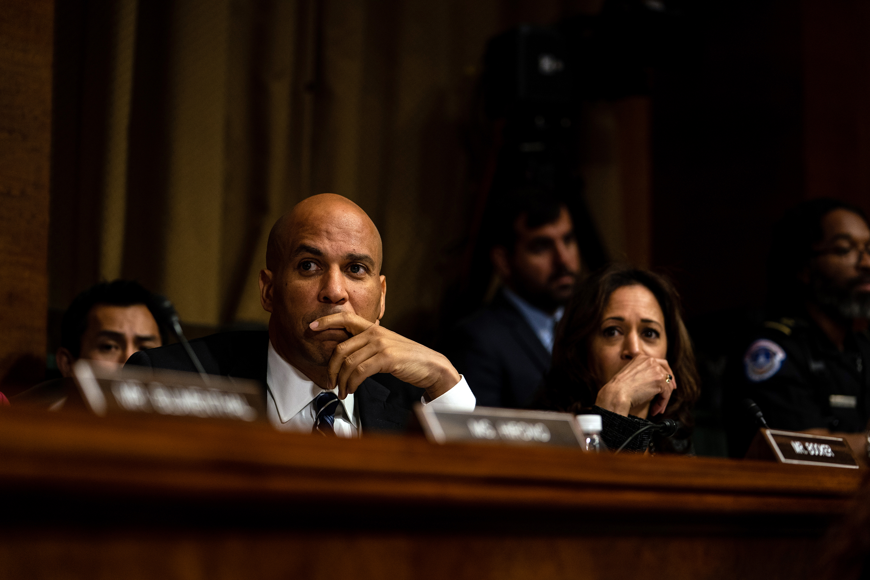 Sens. Cory Booker (D-NJ) and Kamala Harris (D-CA) listen during testimony on Sept. 27.