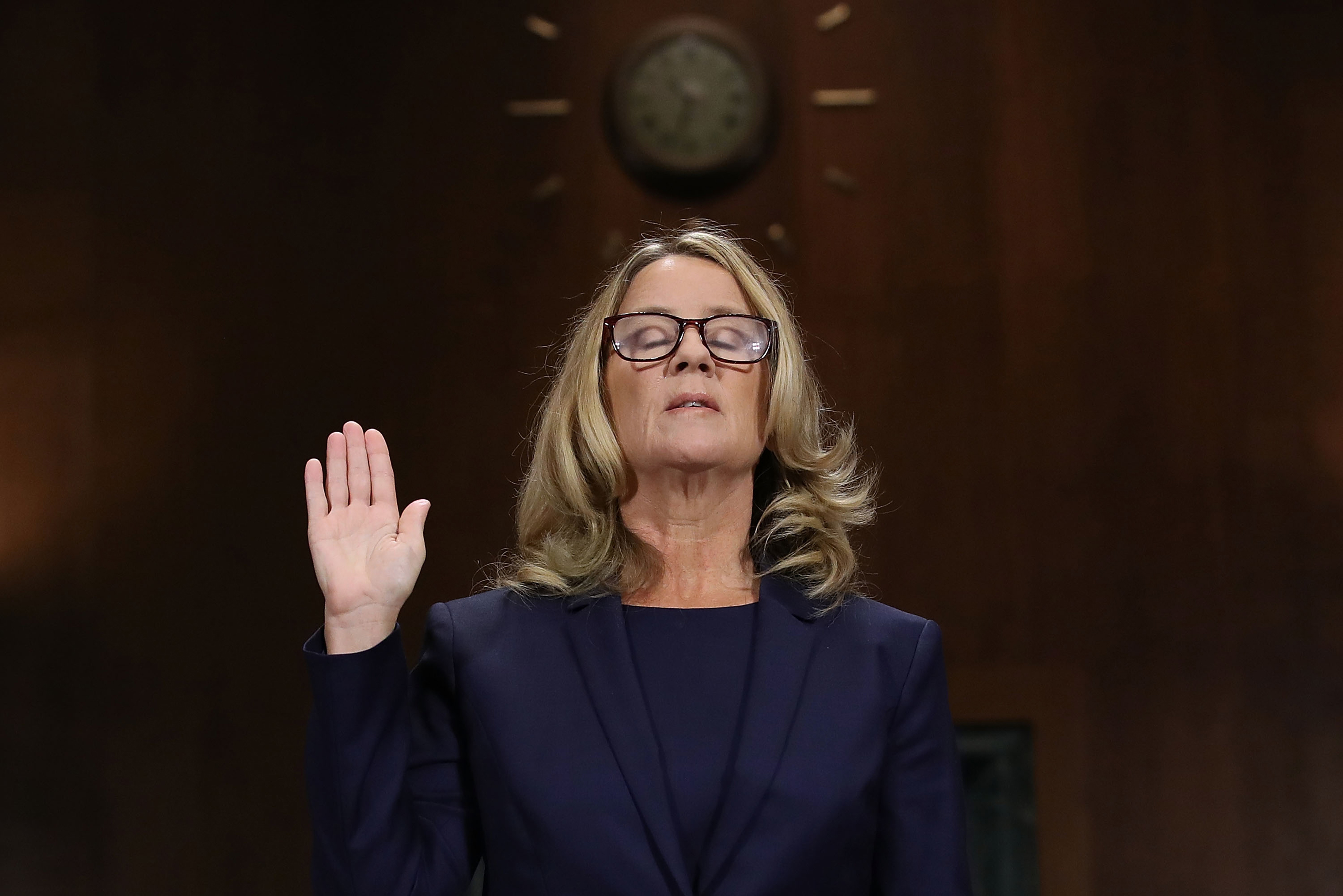 Christine Blasey Ford is sworn in before testifying to the Senate Judiciary Committee on Capitol Hill in Washington on Sept. 27.