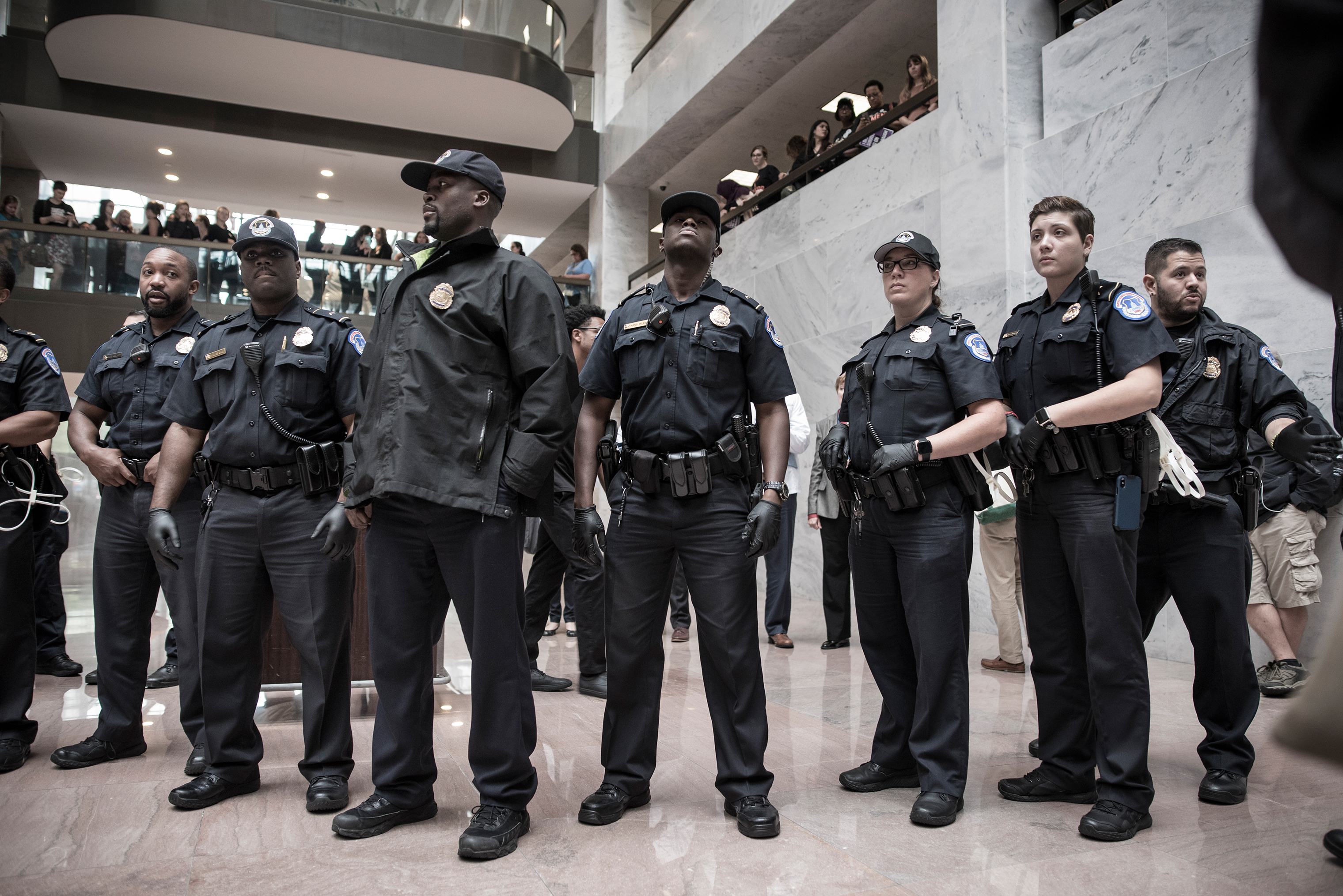 Police gathered to oversee protesters on the ground floor of the Hart Senate Office Building, which is near where the hearing will take place.