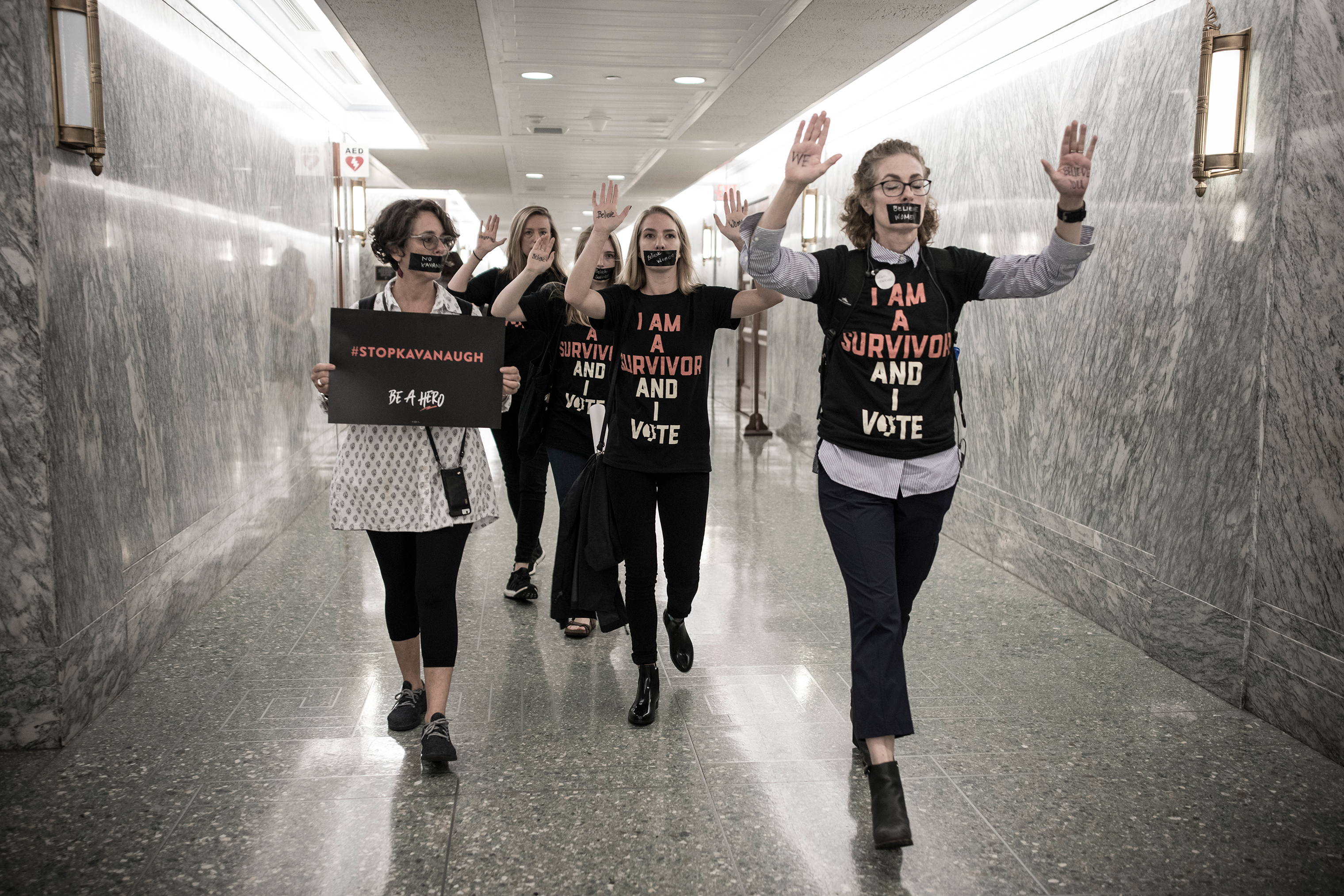 Protesters walk through the hallway of the Dirksen Senate Office Building on Sept. 27.