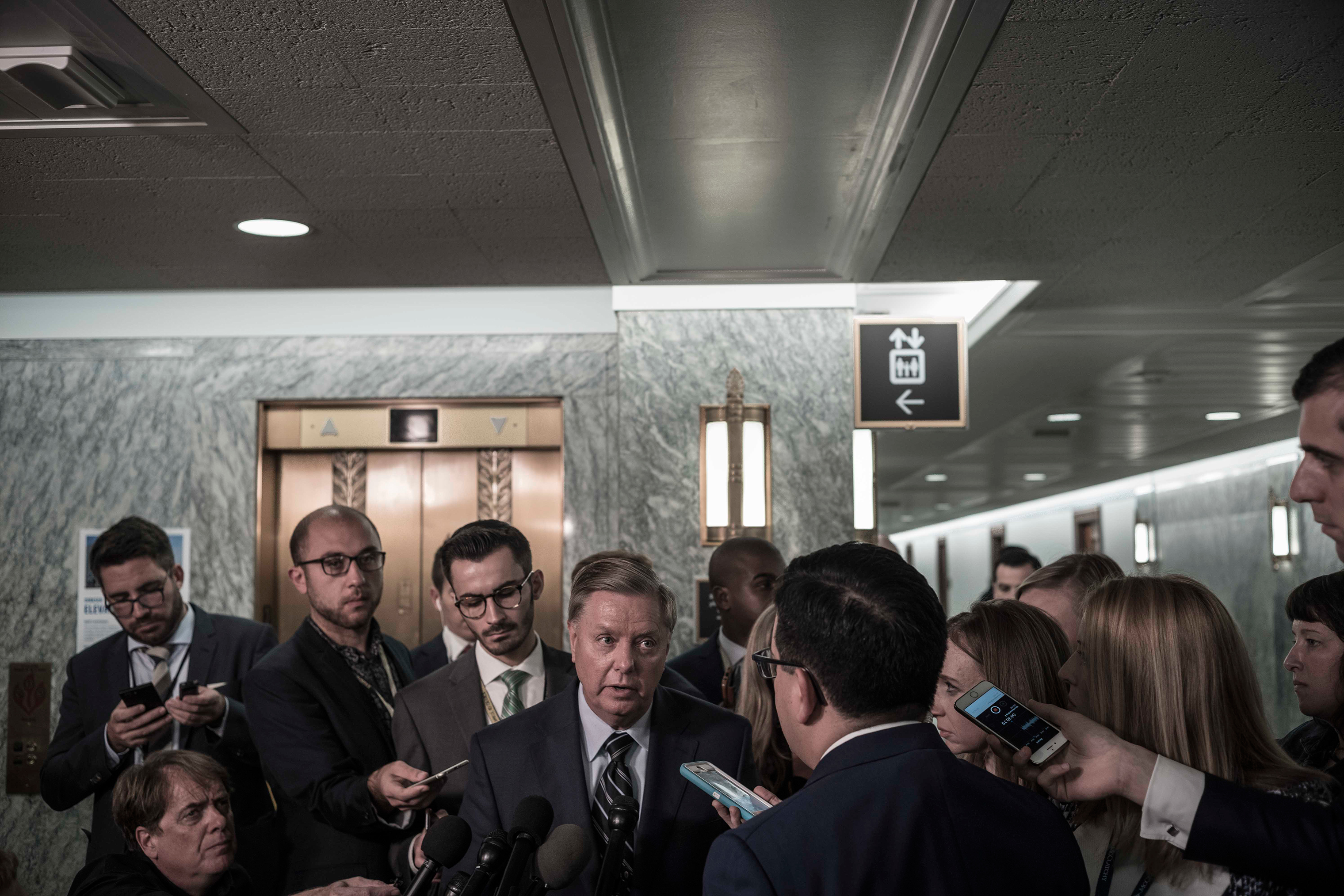 Sen. Lindsey Graham speaks with reporters after the testimony of Christine Blasey Ford on Capitol Hill on Sept. 27.