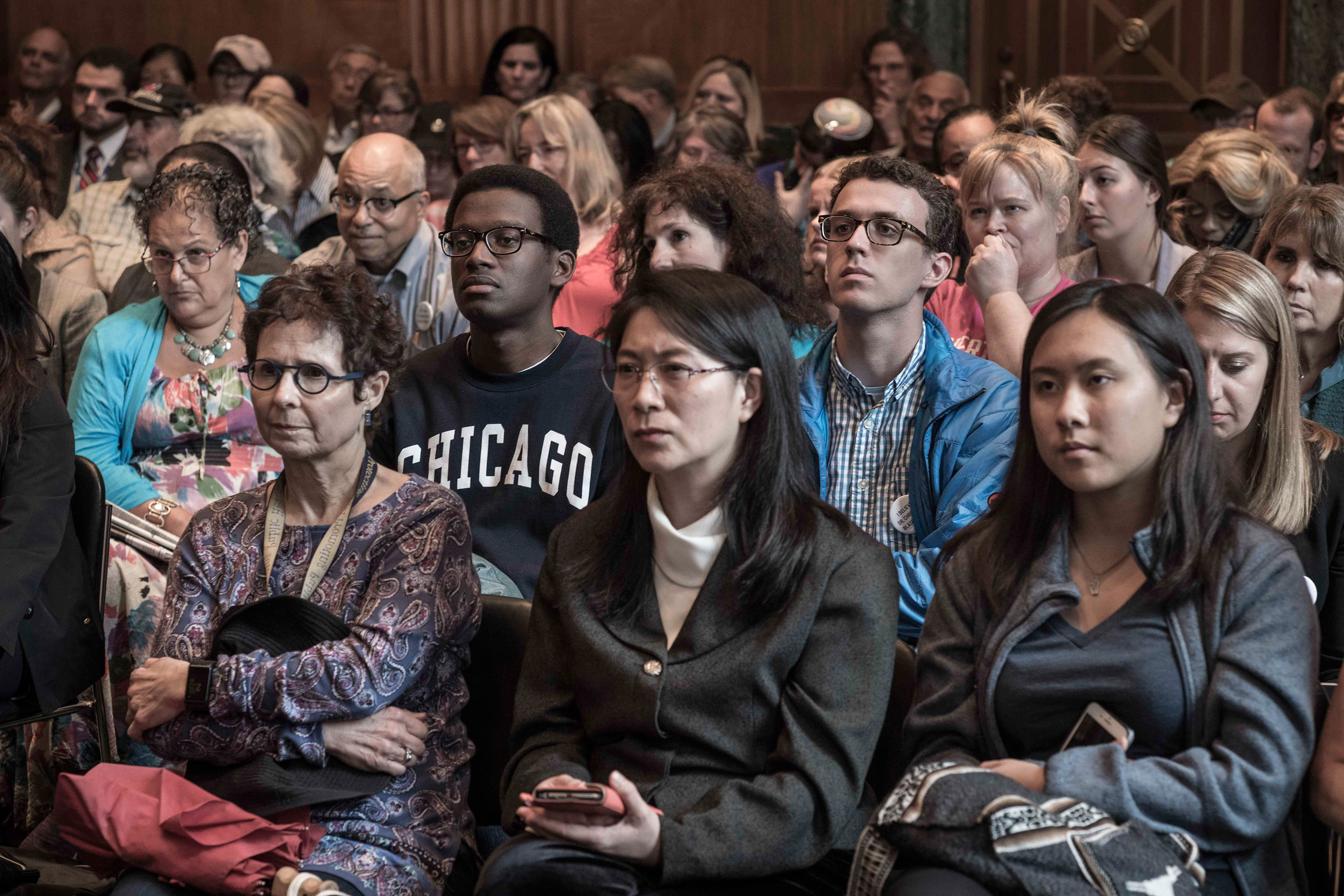 Members of the public watch the testimony of Christine Blasey Ford In a hearing room in the Dirksen Senate Office Building on Sept. 27.