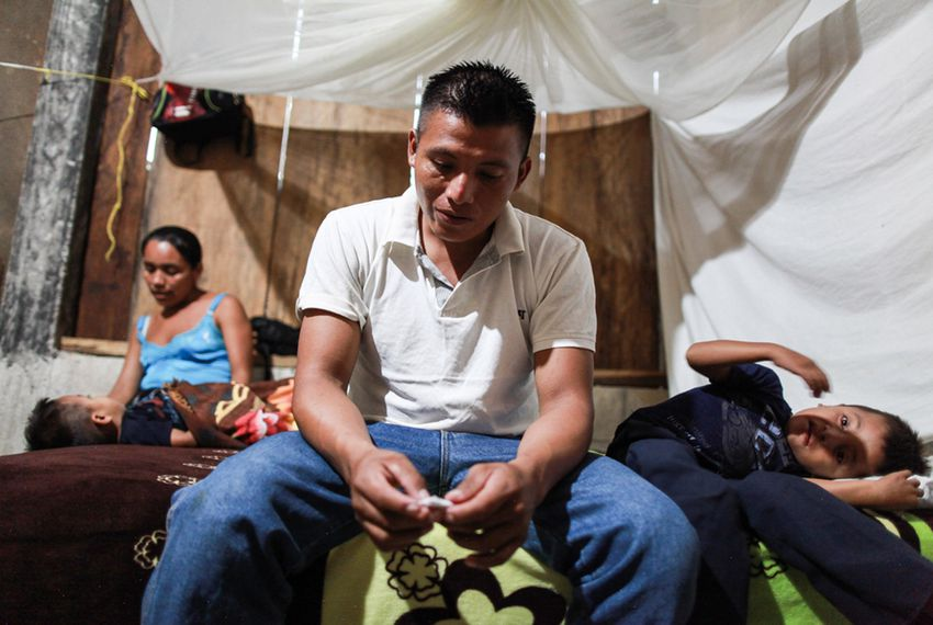 David Xol, his wife Florinda Bol and two of their sons at their home in San Miguel Limón. Xol made his way across Mexico with his third son, eight-year-old Byron. Xol was deported back to Guatemala; Byron remains in a shelter in Baytown.  Carlos Sebastián/Nómada