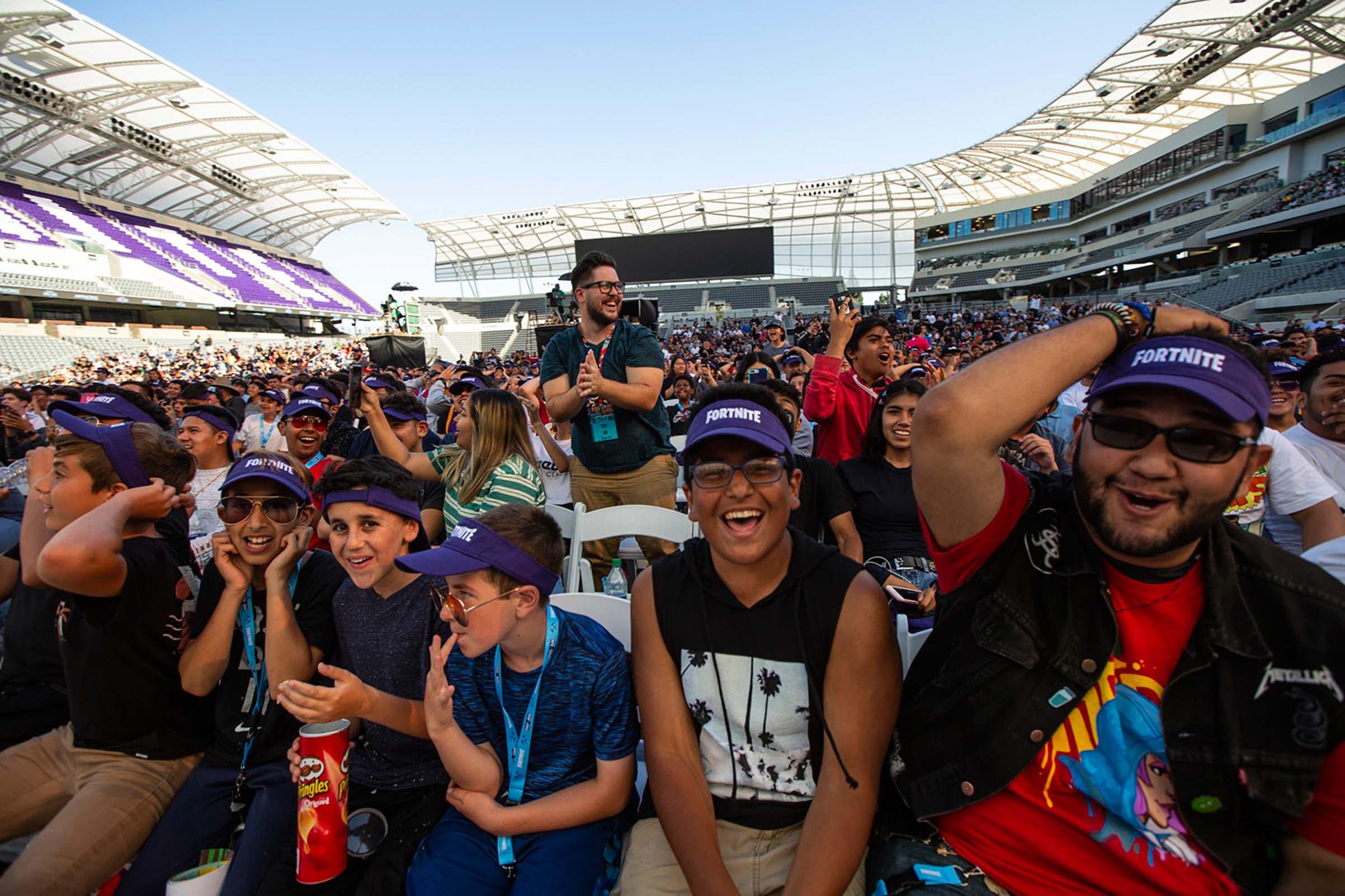 Gamers cheer during the Epic Games Fortnite E3 tournament in Los Angeles on June 12