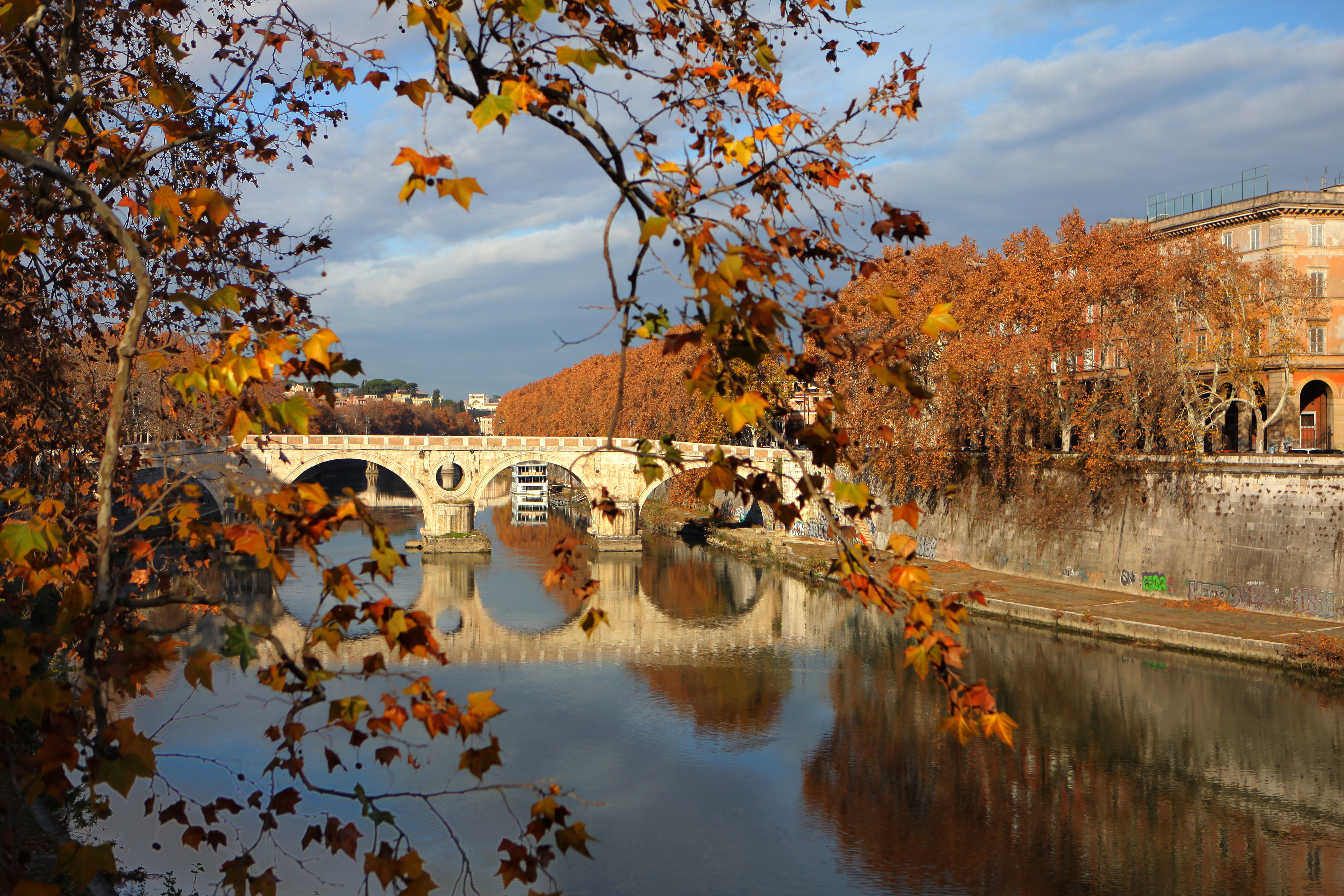 The Ponte Sisto is reflected in the River Tiber on a warm Autumn morning on December 10, 2017 in Rome, Italy.