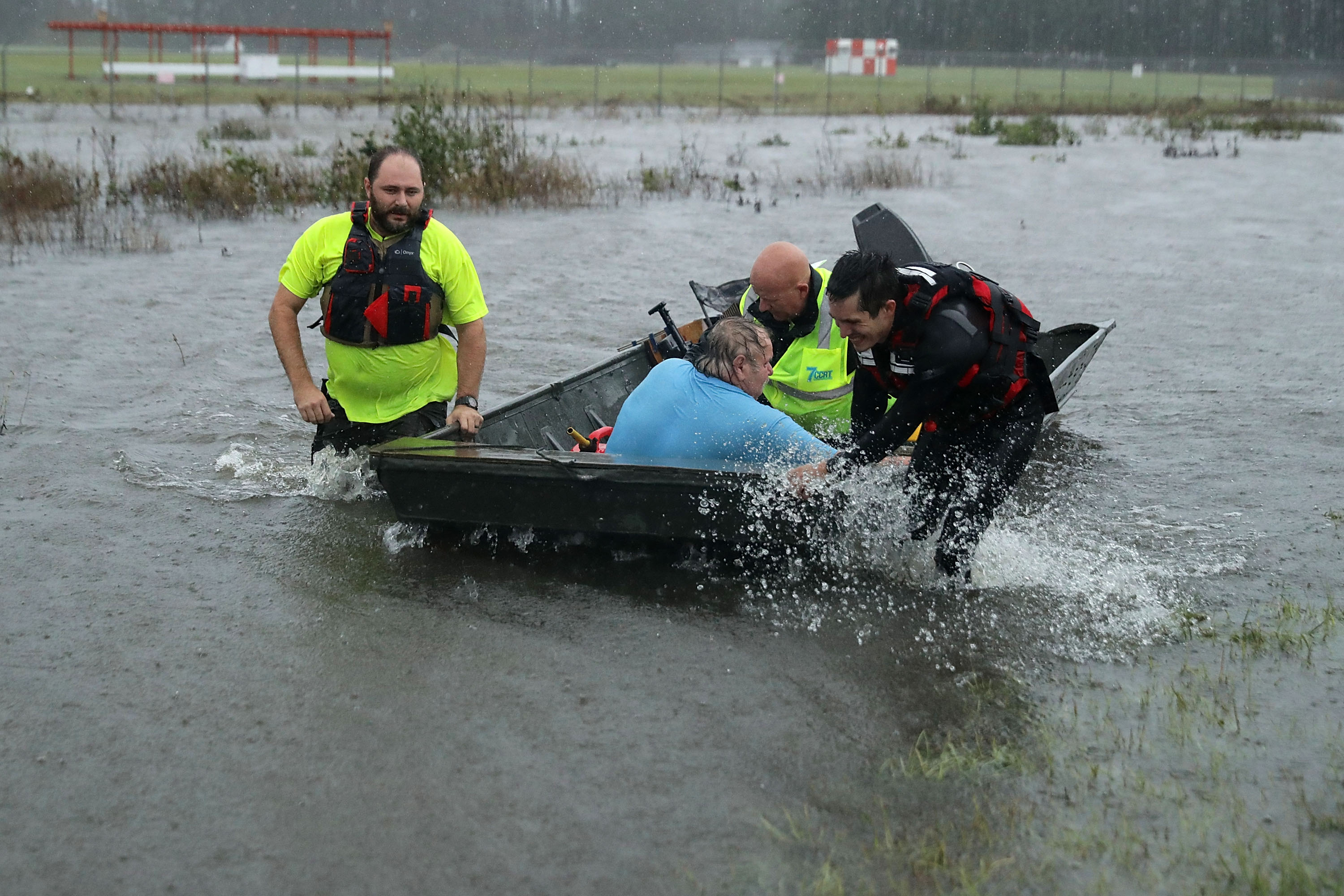 Volunteers from the Civilian Crisis Response Team rescue a man with chest pains from his flooded home  in James City, NC on Sept. 14, 2018.