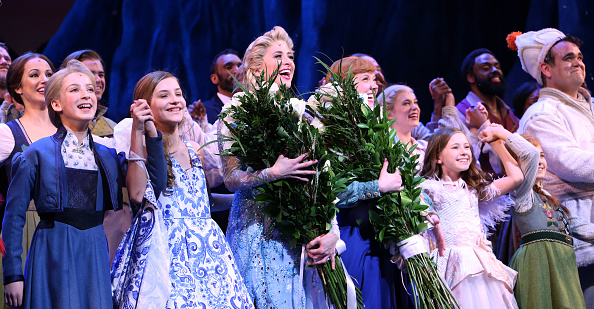 Caissie Levy and Patti Murin with cast during the Broadway Musical Opening Night Curtain Call for 'Frozen' at the St. James Theatre on March 22, 2018 in New York City.