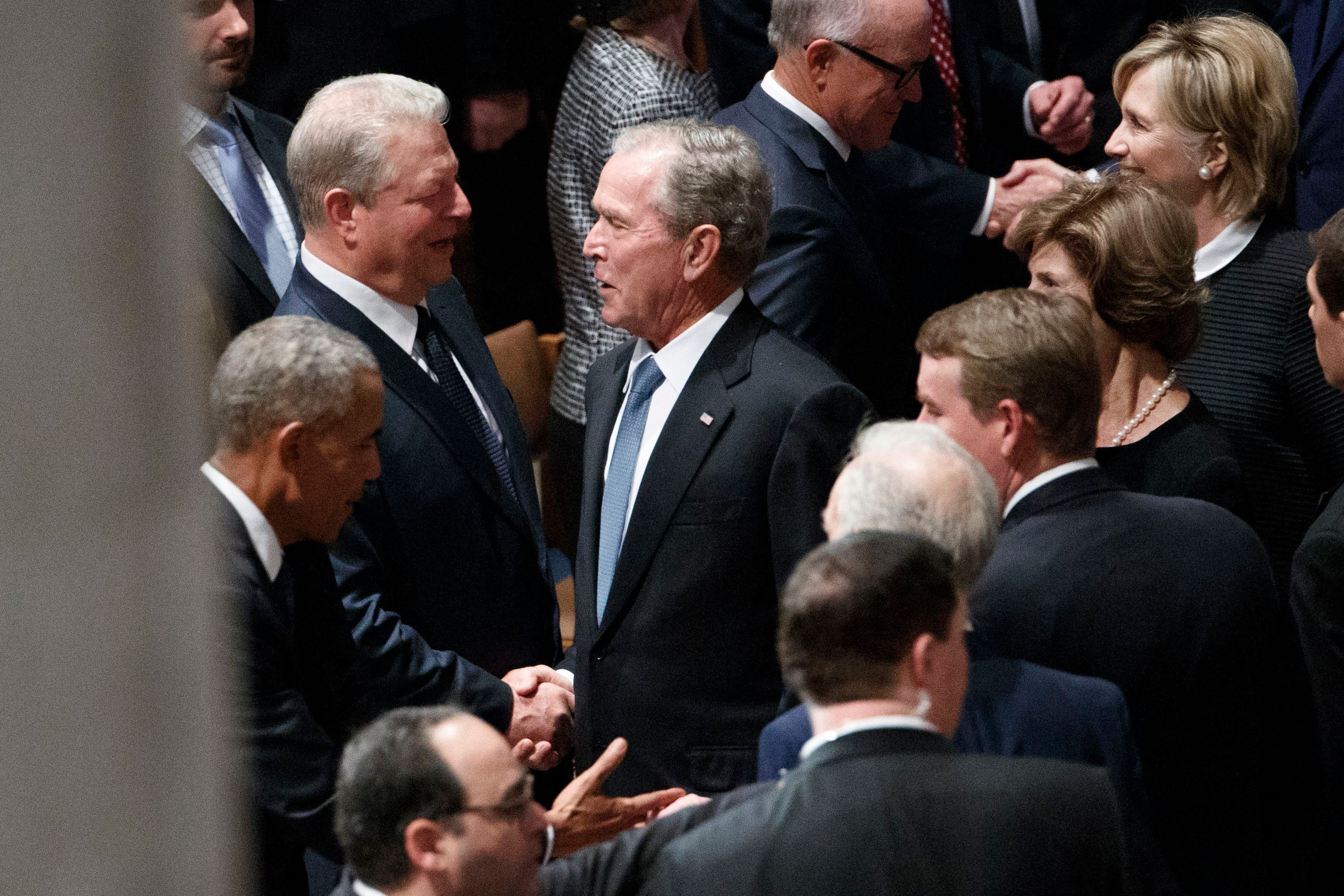 Former US President George W. Bush and former Vice President Al Gore – bitter political rivals – shake hands and John McCain's funeral at Washington National Cathedral Saturday, Sept. 1, 2018.