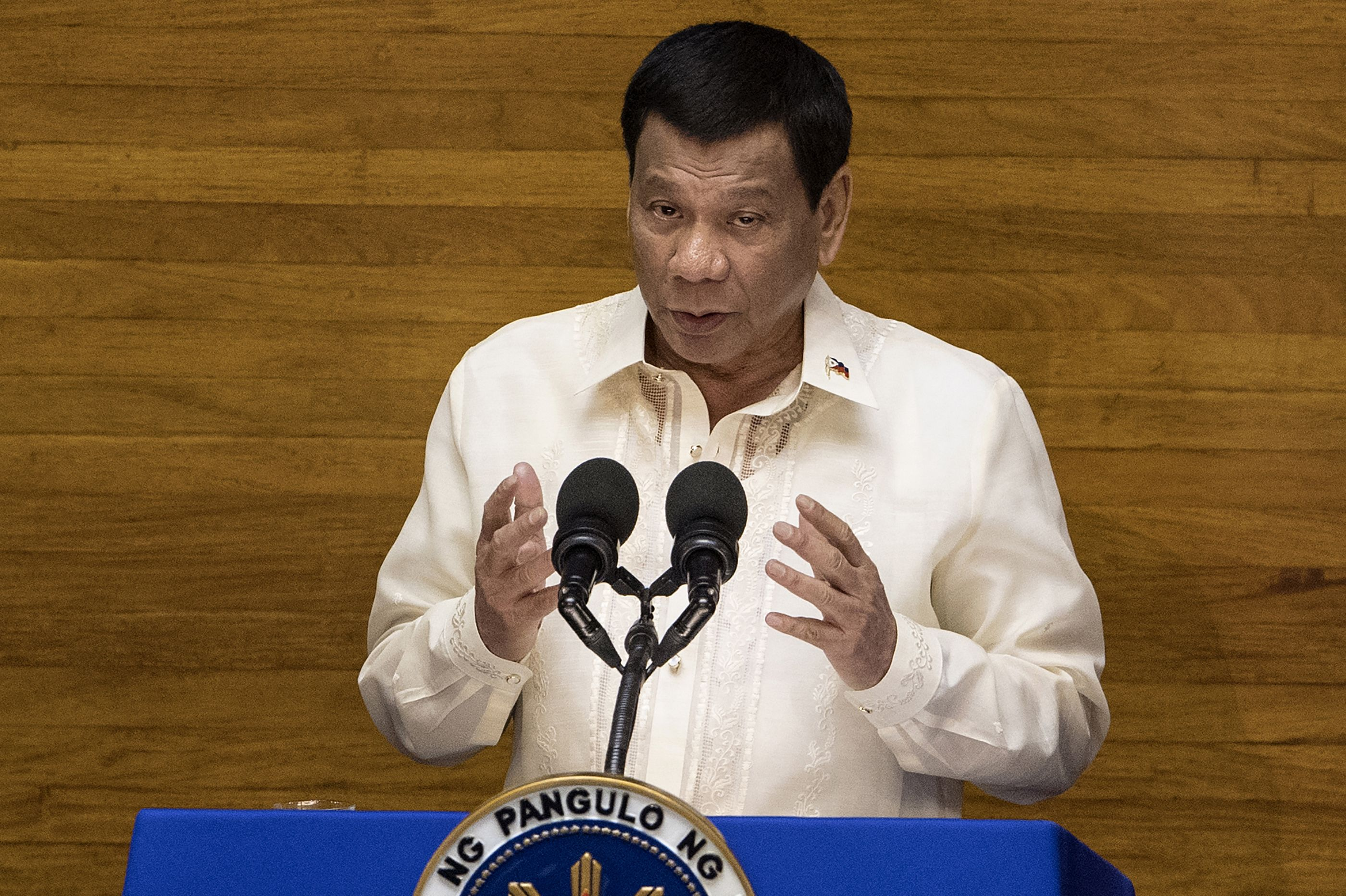 Philippine President Rodrigo Duterte gestures as he delivers his state of the nation address at Congress in Manila on July 23, 2018.