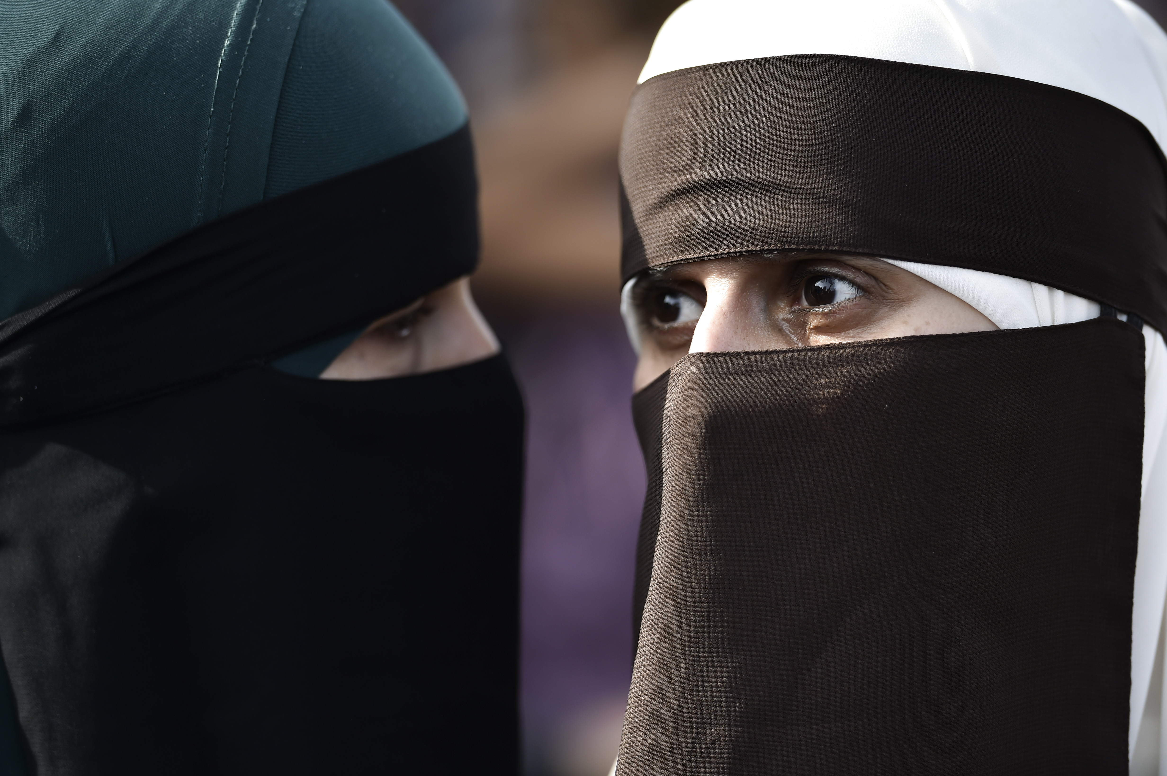 Women wearing niqab to veil their faces take part in a demonstration on August 1, 2018, the first day of the implementation of the Danish face veil ban, in Copenhagen, Denmark.