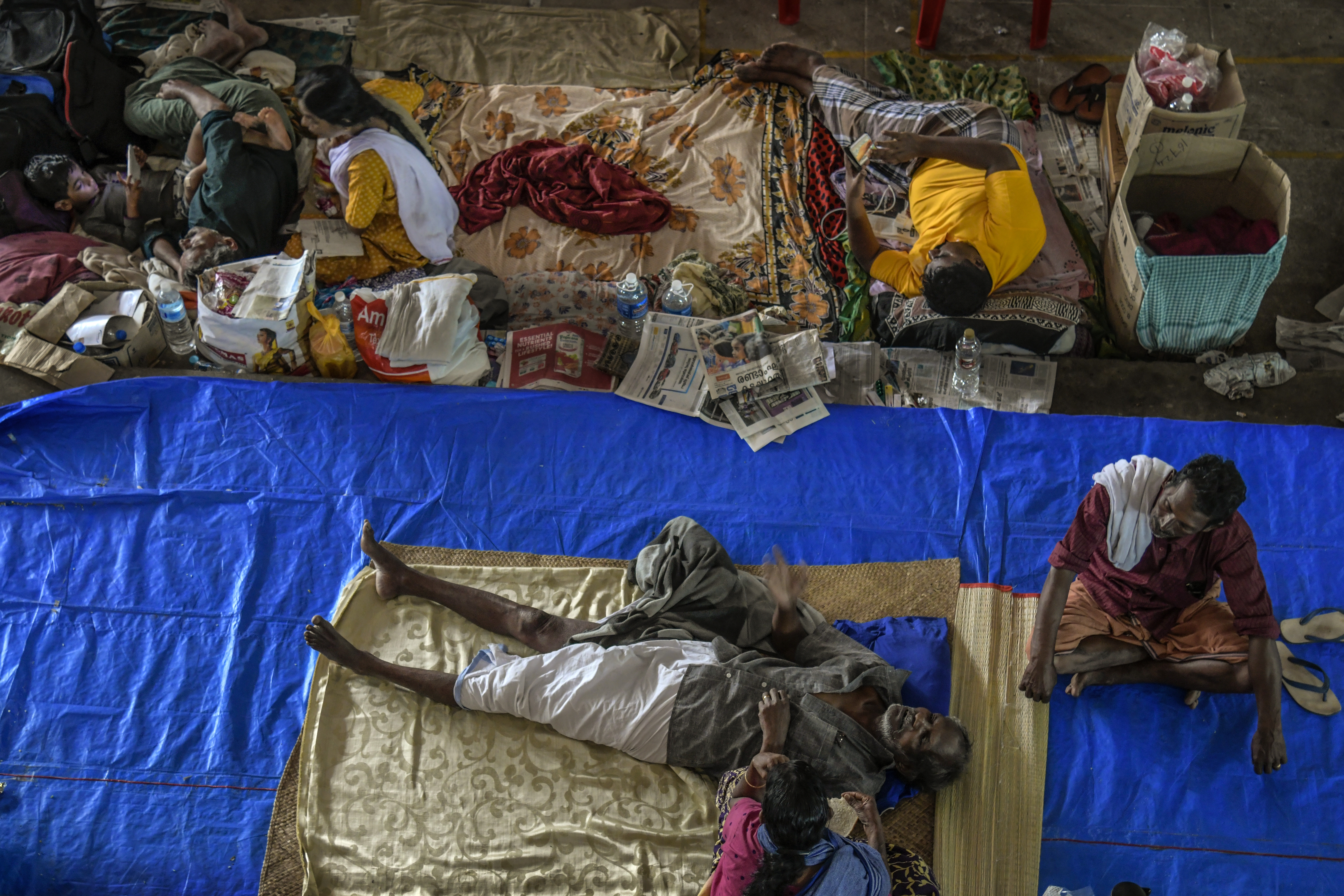 People rest at a relief camp in Aluva in Kerala, India on Aug. 22, 2018.