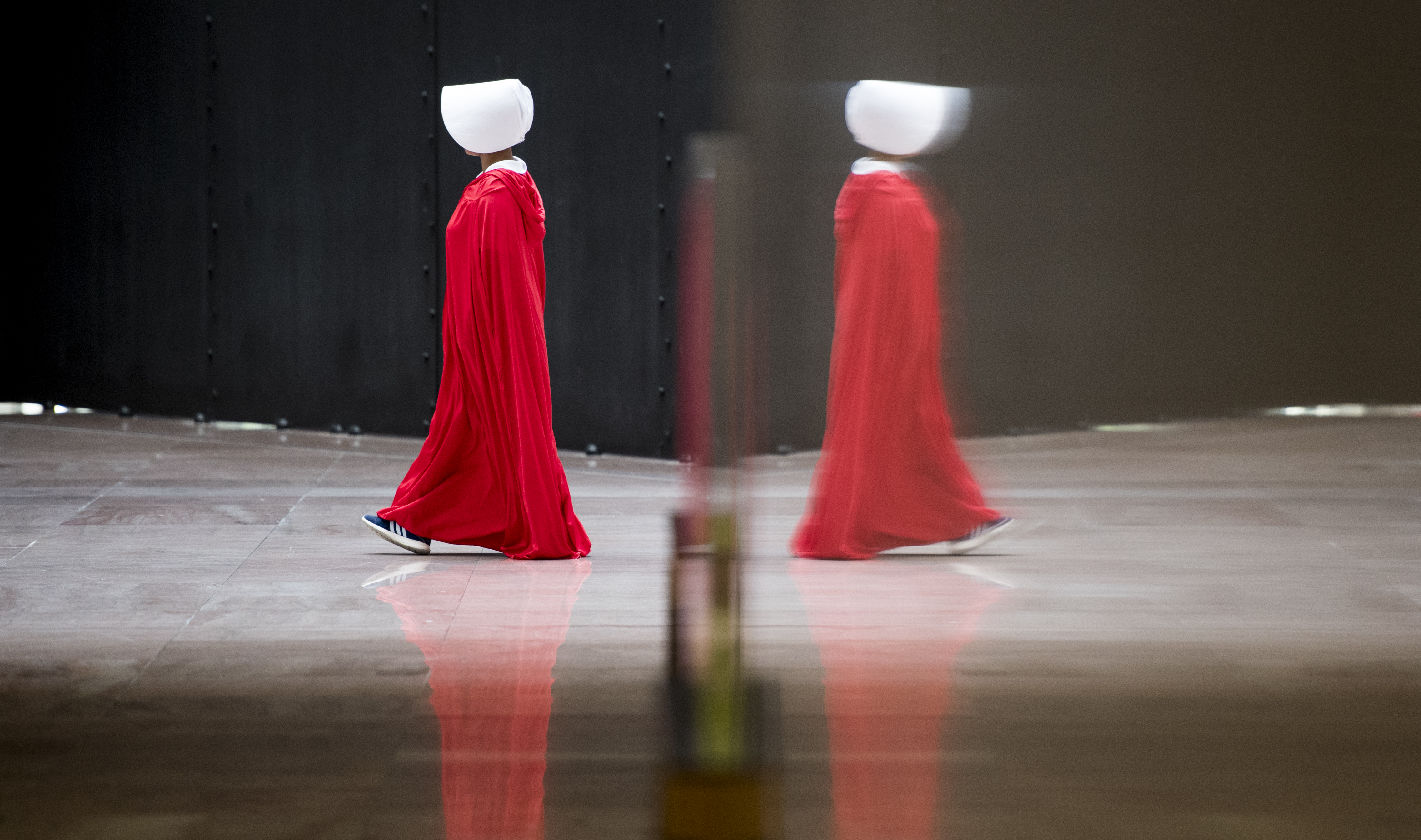 SEPT. 4: One of a dozen protesters dressed in The Handmaid's Tale costumes walks in a circle in the atrium of the Hart Senate Office Building during the confirmation hearing of Brett Kavanaugh
