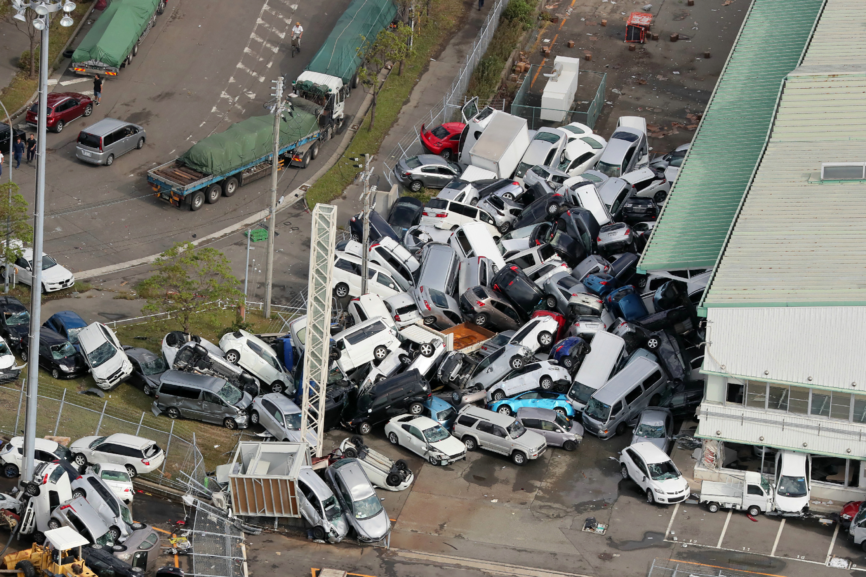 Vehicles piled in a heap due to strong winds in Kobe, Hyogo prefecture, Japan on Sept. 5, 2018, after typhoon Jebi hit the west coast of Japan.