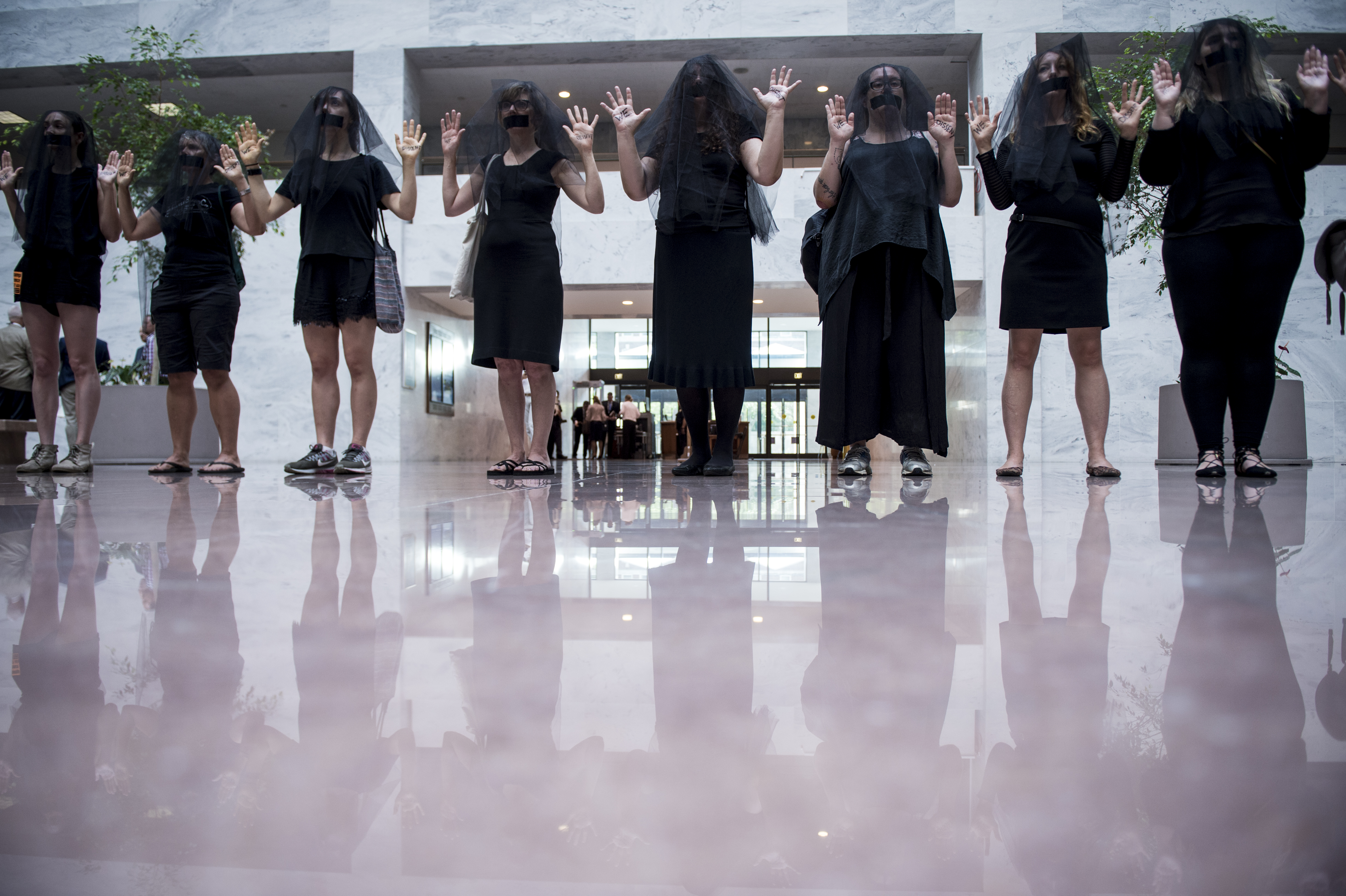 A group of women are seen wearing black veils and black tape over their mouths outside of the fourth day of Brett Kavanaugh's hearing before members of the Senate Judiciary Committee in the Hart Senate Office Building Friday Sept. 7, 2018. (Sarah Silbiger--CQ Roll Call)